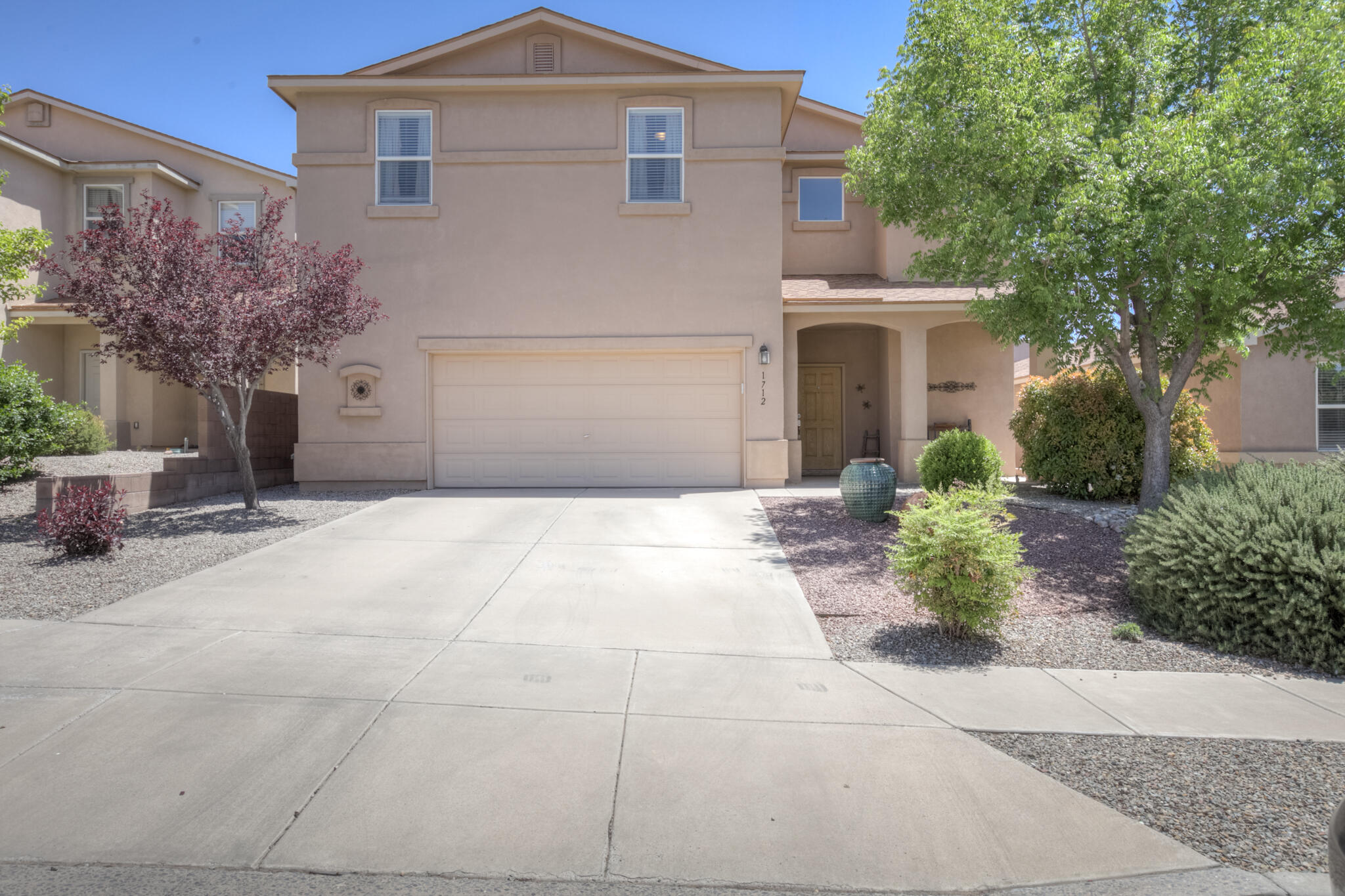 Well kept & excellent floorplan in the sought after Cabezon neighborhood! This property features 4 bedrooms + large loft upstairs & inlaw suite/5th bedroom on the main level w/ 3/4 bathroom. Spacious great room has gas fireplace and opens to the kitchen & dining areas. The kitchen has newer stainless appliances, corian countertops, walk-in pantry and feels light & bright. The master bedroom is oversized w/ plenty of space for an additional seating area. Master bathroom has 2 sinks, separate shower & garden tub + walk-in closet!  Excellent storage throughout. The backyard is nicely manicured w/ a lawn, auto sprinkler/drip system & covered + open patio spaces. Located w/ easy access to parks, grocery stores, restaurants, hospitals & schools! Schedule your private showing w/ a Realtor today!