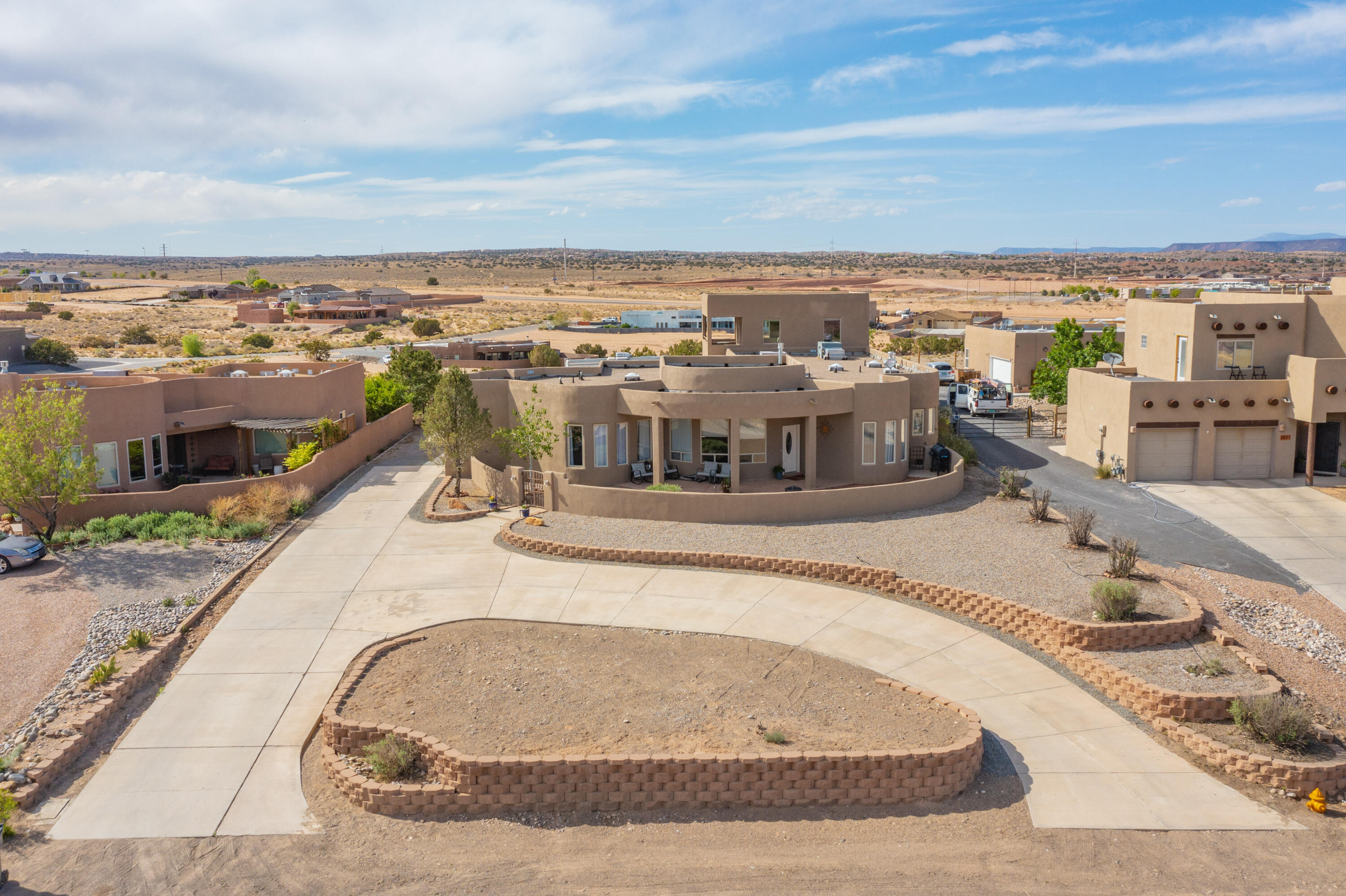 Modern New Mexican Style Home on 1 Acre THIS IS THE PROPERTY that you have been waiting for! 5 Bedrooms, 3 Bath Awesome 4 Car Garage, 2 of which is heated,   Get it ready to be your workshop...You have to see the views!  Look No Further - Schedule your private viewing today!