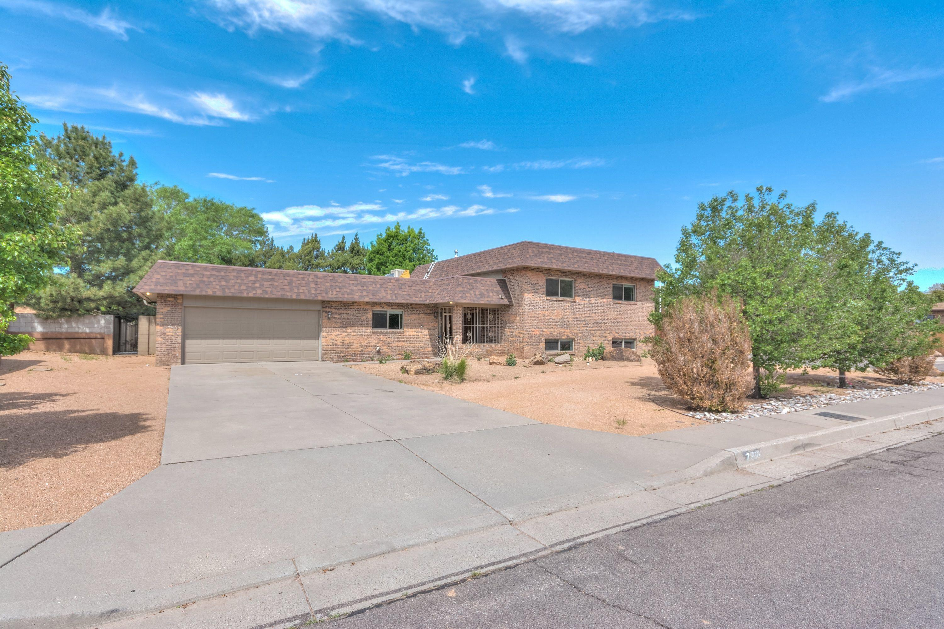 This beautiful property is in the esteemed Northridge subdivision of NE ABQ. Located on a large corner lot in a Cul-de-Sac, this split-level home is move in ready!  Boasting two living areas, one of which can be converted into another bedroom or guest room. Side yard access and back yard access is available for RV parking or other toys!  Close to Whole Foods and Starbucks. Come see it today, this home will not last long!