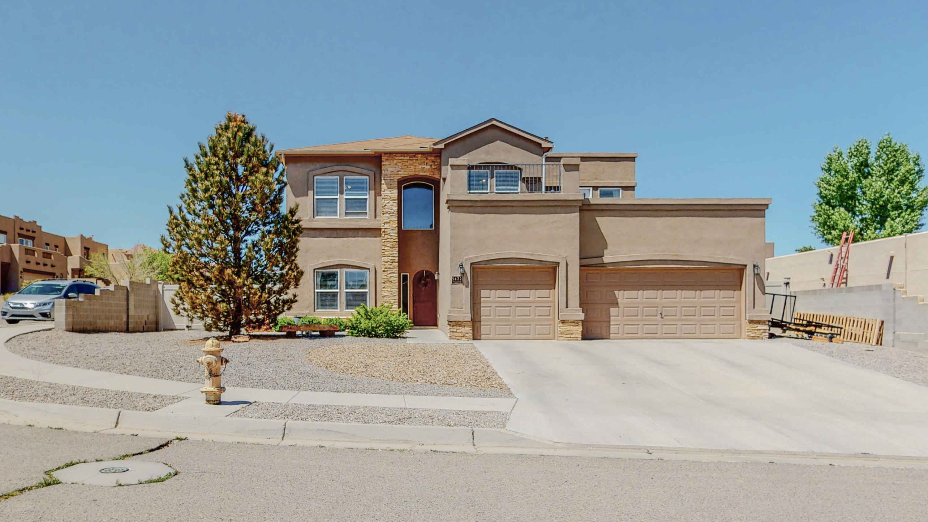 OPEN HOUSE Saturday, May 15 11-1. Take a look at this beautiful, spacious 2-story home with a pool located on a corner lot in the Enchanted Hills neighborhood of Rio Rancho. The floorplan features 5 bedrooms, 3 bathrooms & 3500 square feet of living space. The first floor features an open concept kitchen/dining/living area, an office, one bedroom & a full bath. Upstairs you'll find 4 bedrooms, 2 full baths, & a huge loft space perfect for a game room. The master bedroom offers a balcony, large bathroom & an oversized walk-in closet. The private backyard boasts an in-ground, heated gunite pool as well as a concrete pad, & backyard access. Other features include a large pantry & 3-car garage. Located close to shopping & dining, this home offers amazing space & fabulous outdoor living.