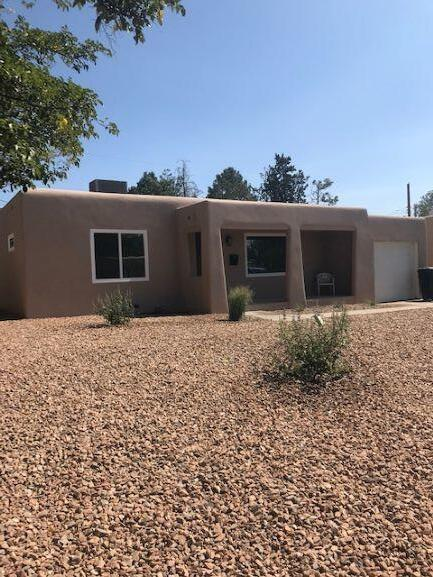 Welcome home to this completely remodeled home!  2BR + office, 1 BA, large living area, separate DR and spacious kitchen.  Lots of natural light with new windows, roof , appliances, flooring, stucco and HVAC.  Private fully landscaped yard and a single car attached garage.