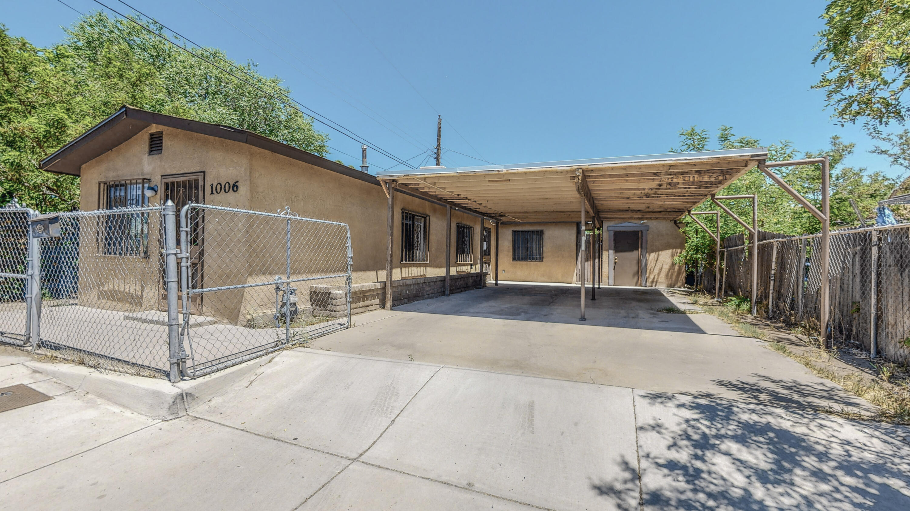 Come and check out this gem located near downtown Albuquerque.  This 2 BR 1 BA home has tile, laminate, and brick flooring throughout.  It also has 1 large 2 car carport and storage shed!  At this price, this home won't last long!