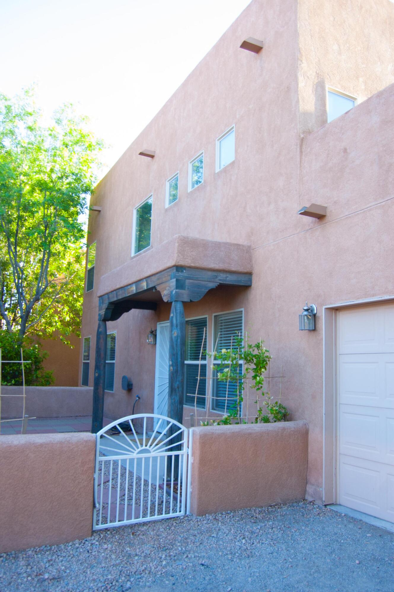 This beautiful townhome in the much desired Los Jardines subdivision is a must see. Owner's suite and bathroom on the main floor, 2nd bedroom and full bathroom upstairs along with storylight windows.  Stainless steel appliances, large patio and great natural light make this a must see. Please call today to schedule your private viewing.