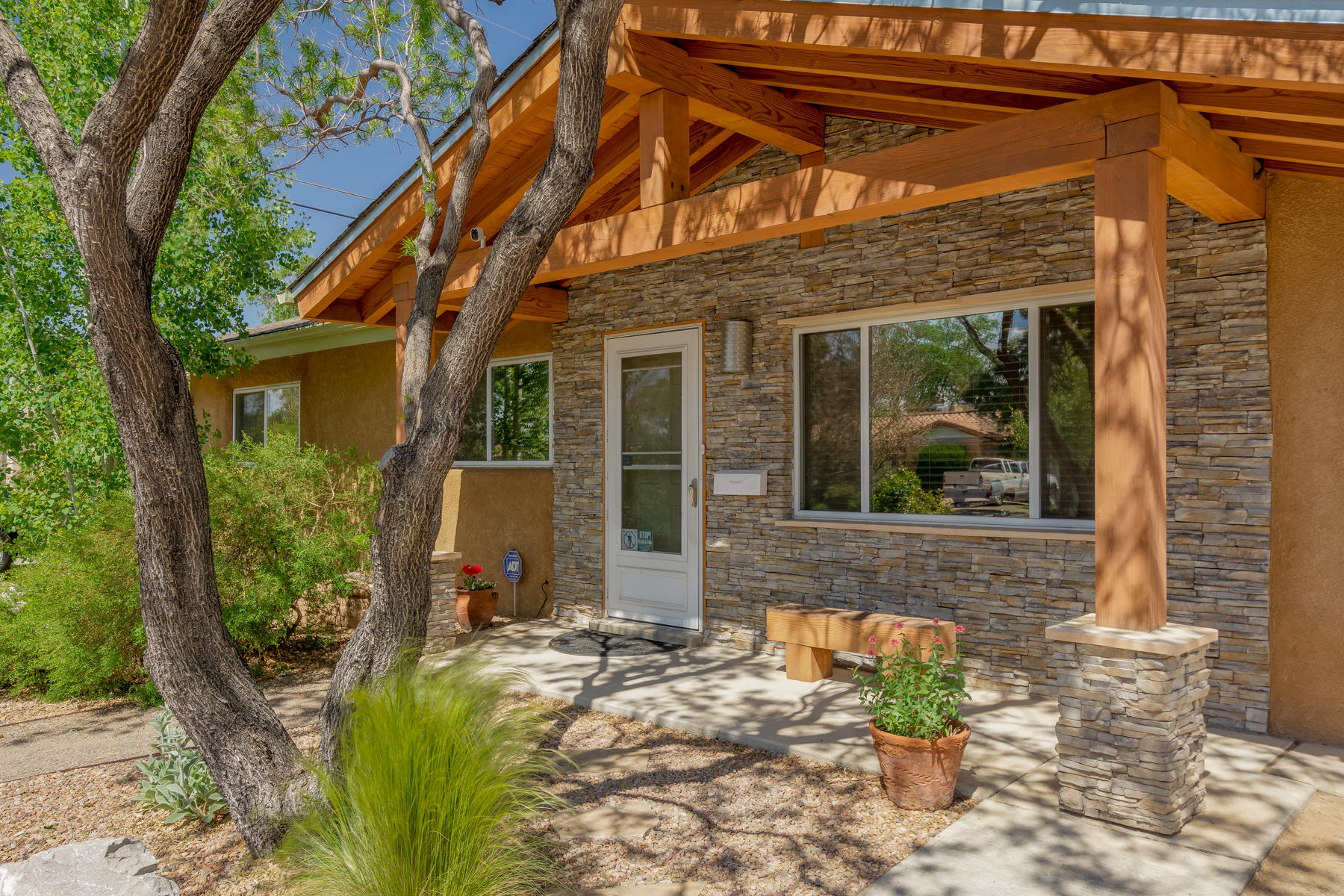 Looking for a statement? Here it is! The large timber entry greets you with a touch of alpine-chic. Beauty and simplicity throughout the home and yards. Updates include stainless appliances (2017), new roof (2018), York combo HVAC (2020). Thermal windows throughout (west facing have solar glare/heat reducing tint). Updated kitchen cabinets & corian countertops w/integrated sink. Owners suite has well appointed bath fixtures featuring cherry vanity (floating) and built-in linen cabinet. The dining/family/primary bedroom addition give everyone their space. Three more bedrooms & an updated full bath. Sitting under the backyard pavilion you will find a private wellness zone. Fully landscaped yards. Don't miss the hot tub and workshop/storage. This is a very special property!
