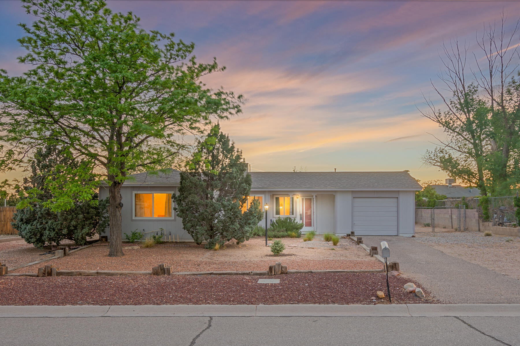 WOW - this charming, well maintained bungalow in Rio Rancho is not going to last long! New beautiful laminate floors grace the cozy living and dining rooms. Other notable improvements include a new furnace (3/2021), a new(er) roof (5 years old), a new(er) Mastercool (5 years old) and windows replaced in 2006. Need room for multiple vehicles or play space? A large backyard with backyard access on BOTH sides of this lot gives you plenty of room. This is a great investment opportunity - where it's your first home, your retirement home or anything in between, this adorable home is waiting for you.