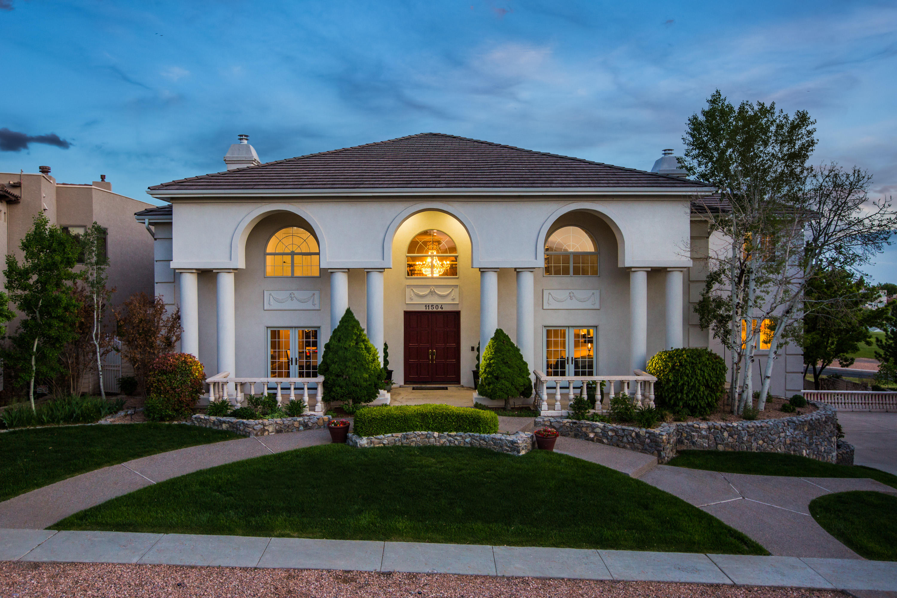 A stunning tri-level residence inspired by custom builder Thomas Springer, complete with views in every direction. This home overlooks a magnificent panorama of the Sandia Mountains, and the city lights of Albuquerque below stretching as far as the eye can see. Its .4 acre encompass a wealth of luxurious amenities, including a chef's kitchen offering you custom cabinetry by Ernie Torres, Sub-Zero, Viking, travertine backsplash, oak hardwood and travertine flooring, 20' ceilings, secluded lot with room for a swimming pool, and an expansive backyard that backs up to the Tanoan Golf Course. This gorgeous home faithfully reflects the elegance and grandeur so characteristic of a timeless design and is part of Albuquerque's most private and prestigious community, Sauvignon.