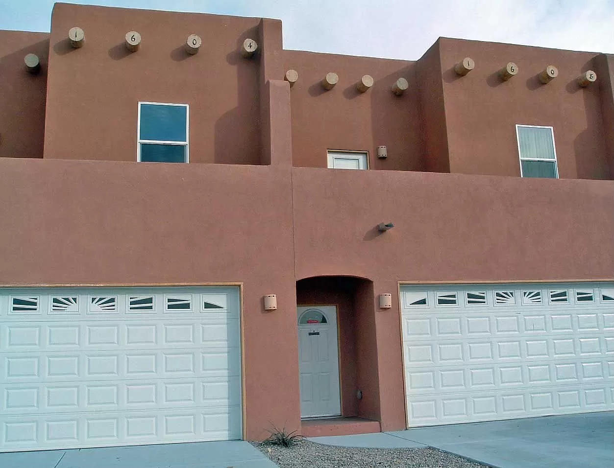 Conveniently located near Downtown Albuquerque, this three bedroom, three bathroom townhouse with custom finishes is ready for you!  Large living and open kitchen.  Spacious bedrooms.  Refrigerated air.   Landscaped backyard with mature trees.