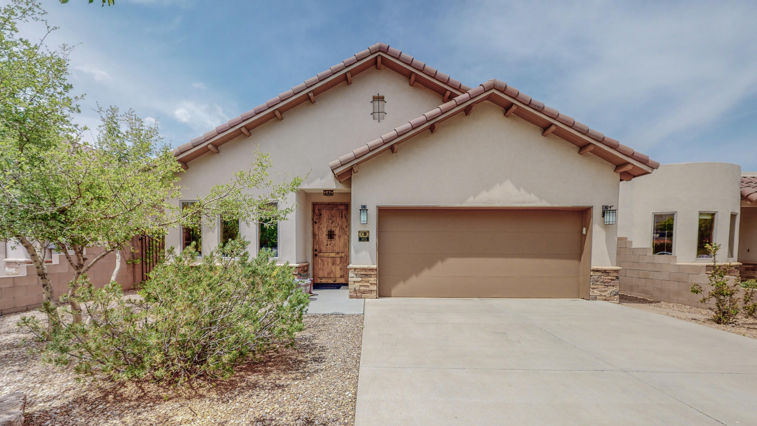 Exquisite home nestled in a small, private, gated community!  Expansive, gorgeous views of Albuquerque and miles to the west.  High quality materials and construction throughout.  Green Built 2008. Sellers took extra care in design of this semi-custom home.  Lovely details from slate entry to oak flooring to clearstory windows to expanded master.  Generous kitchen appointed with granite counters and abundant cabinetry, built in pantry and buffet.  Kitchen nook and formal dining.  Private master anchors rear of home -- large master bath with sep shower and garden tub.  Walk-in closet.  2 additional bedrooms with full bath.  Ample storage throughout.  Amazing patio opens to spectacular view and low maintenance yard. Stunning views from much of home. Spiral stair winds to roof loft!