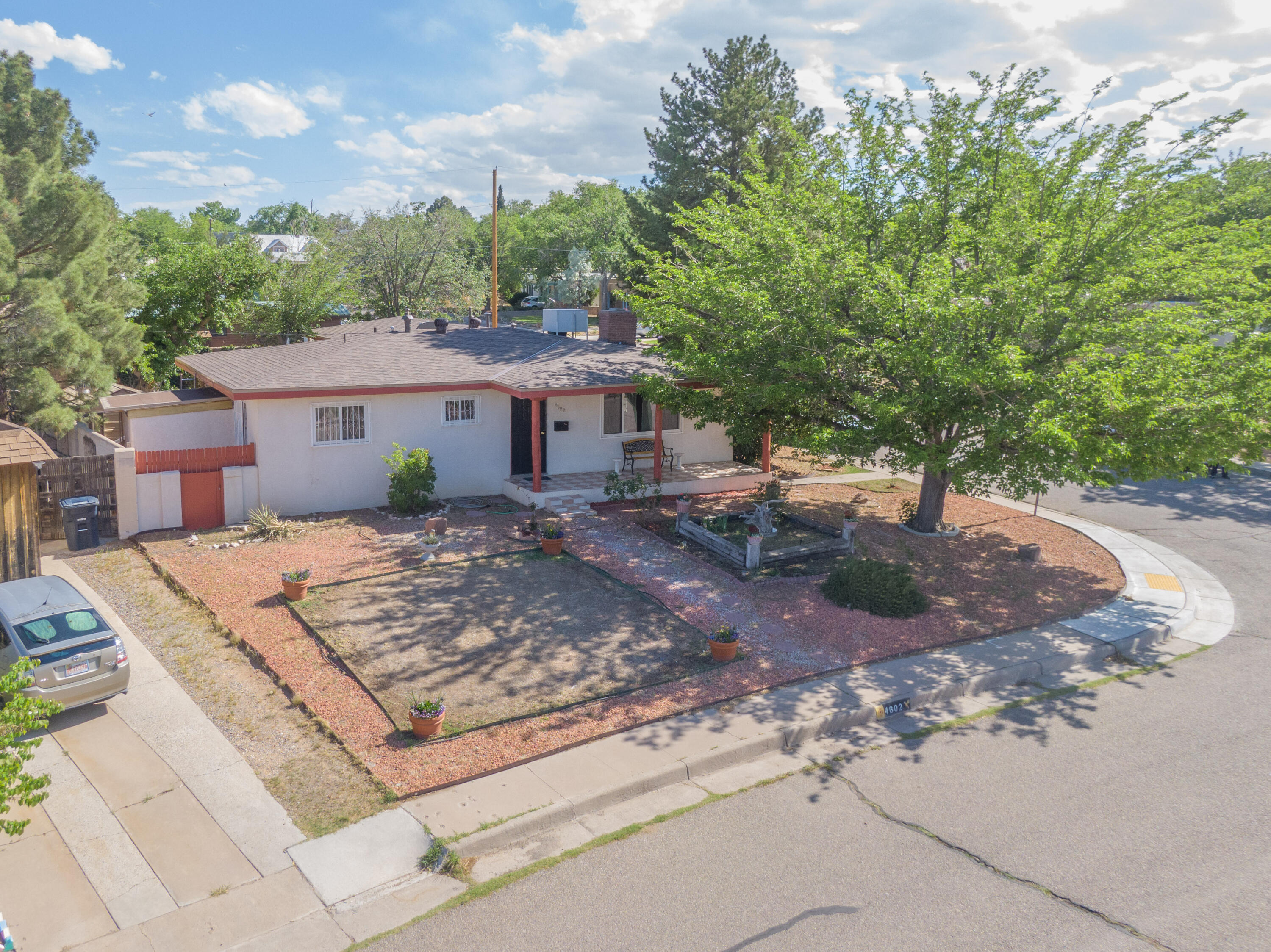 Welcome to this Charming, Single-Story, 3-Bedroom Home in Albuquerque's Sought-After *Ridgecrest* Neighborhood! Situated on a Large, Corner Lot w/ Mature Shade Trees, 4602 Inspiration offers a Flexible Floor Plan with Formal Dining, plus 2 Spacious Living Areas. The Main Living Space presents you with Beautiful, Gleaming Wood Flooring and a Welcoming Wood-Burning Fireplace. The Second Living Area features a toasty Pellet Stove, plus Limitless Possibilities. Envision this Additional Living Space as a Lounge, Game/Rec Room, Exercise Area, Home-Office, or Hobby Room. Newer (2018) Pitched Shingle Roof, Furnace, Water Heater, and Sewer Line! 2 Covered Carport Spaces. Minutes to Nob Hill, UNM, Downtown. Make an appointment to see this Home today!