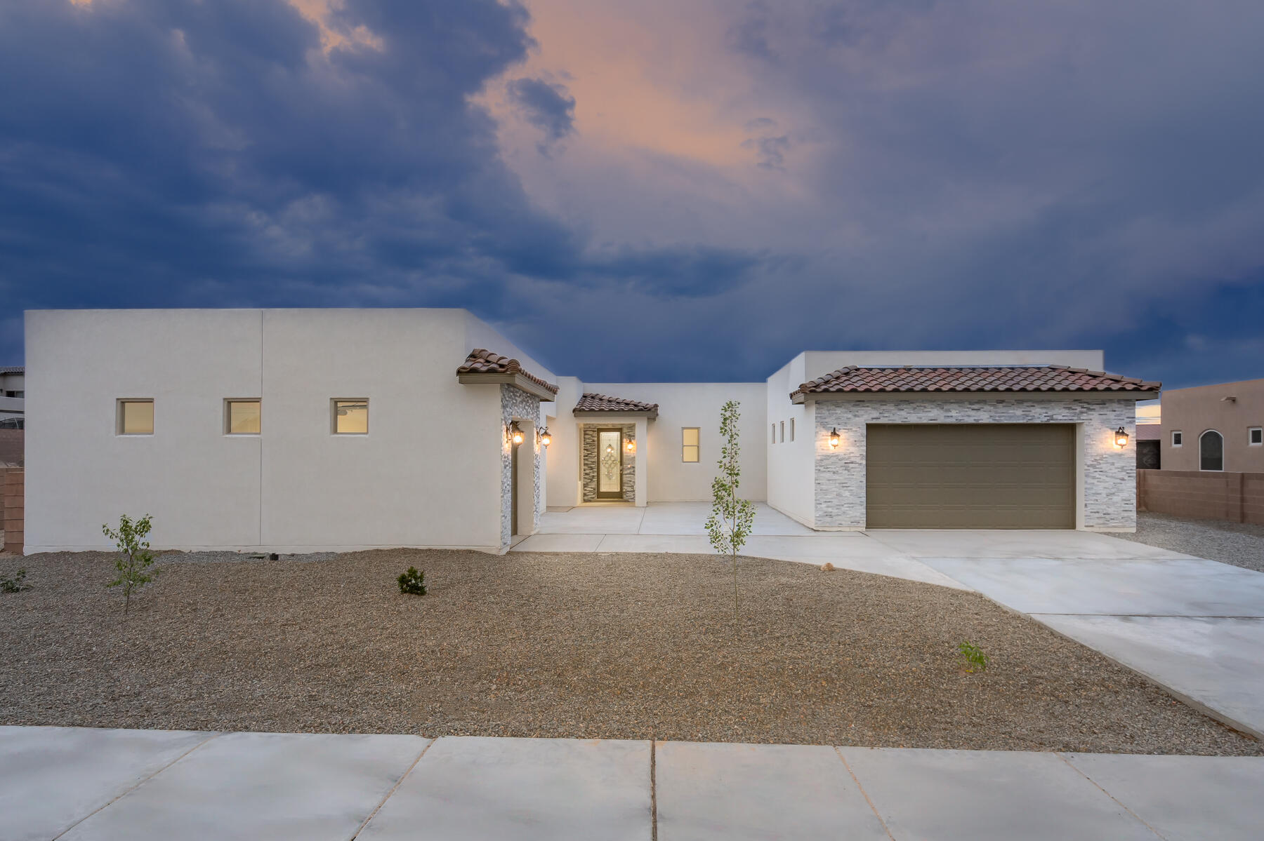 CUSTOM built home in desirable Petroglyph Estates subdivision-NEW CONSTRUCTION-backyard access/RV parking allowed-NO HOA -Perfect for multi-generational families. Has attached Casita with walk in closet and bathroom and works off its own split HVAC system. 3 bedrooms + office in the main house with Jack and Jill bathroom perfect for teens/kids, and masterbath boast huge garden tub with his/her closets and sinks. Quartz countertops throughout home, openfloor plan, large kitchen, 8foot doors, 3 car garage, 4bedroom/3.5 bath-Central air, coffered ceilings in living area.
