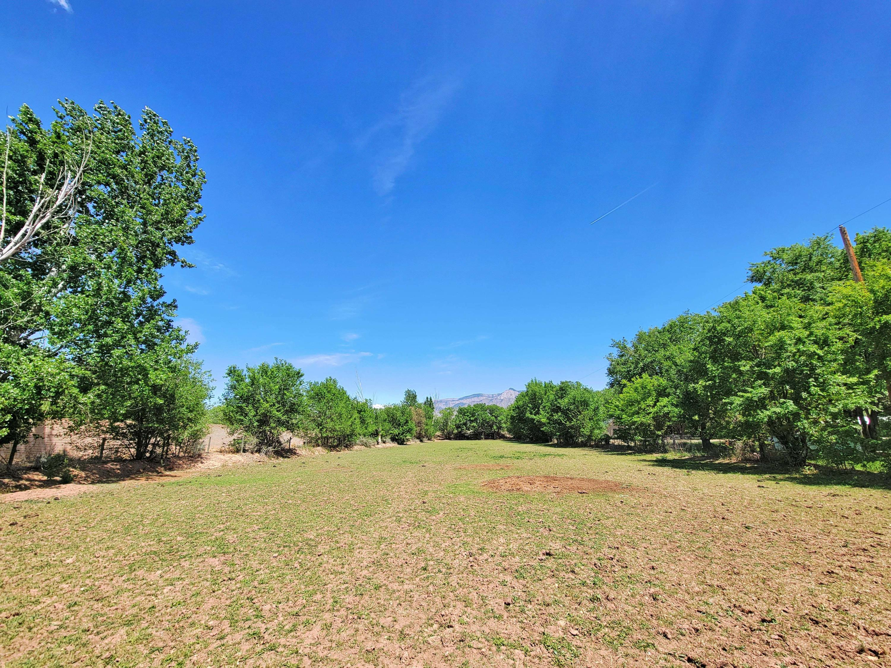 IRRIGATION RIGHTS!  This 1.50+ acre lot in Corrales, New Mexico is about 1,000 feet west from the Rio Grande. The property is approximately 680 feet long. A 1,560 sq.ft. mobile home (26x60) with private well, septic tank, detached garage and storage unit is included. Electricity and gas is also connected. Best of all, you're only about 5 minutes away from the center of the village. The property is being sold as-is. Request the 360 video. *Do not get on property without appointment.