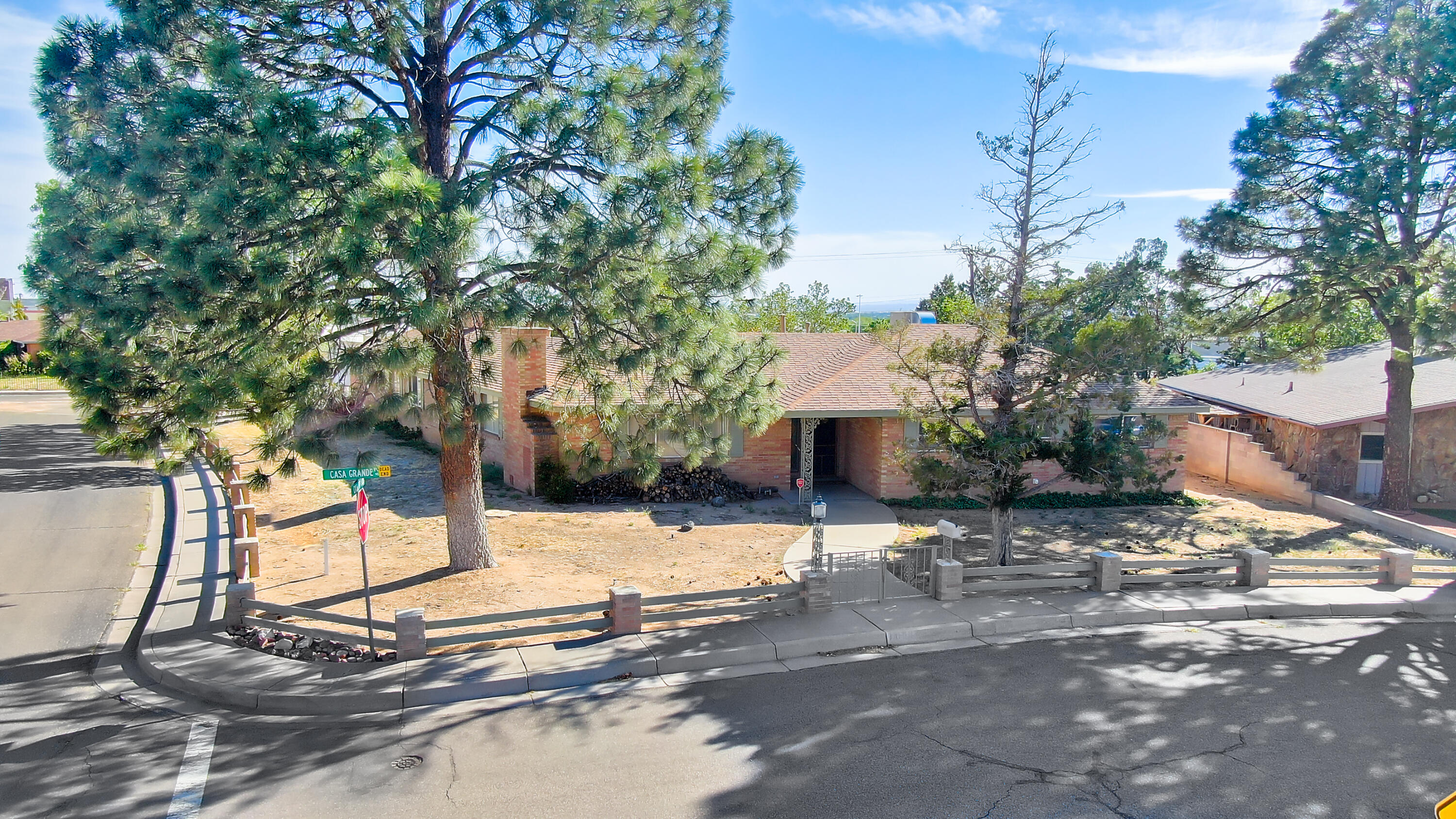 Custom home being sold ''AS IS''.  Located in the highly desirable Monterey Manor Subdivision. Iconic home on corner lot, this home will amaze you with its interesting layout which was designed for entertaining. Home features two living areas, 2 A/C units & 2 Evap units with sun/mud room. 1 fireplace and 1 woodburning stove. Galley Kitchen is adjacent to dining area and large wet bar, perfect for entertaining. Each bedroom has its own bathroom. Another bathroom is in the utility room with both Gas and Electric dryer hookups. King/Queen suite has a dressing area and makeup vanity with full bath. The huge back yard is accessible via seven different doors and has a 74' long angled portal style covered patio overlooking a huge back yard with back yard access RV pad & neighbors on only one side