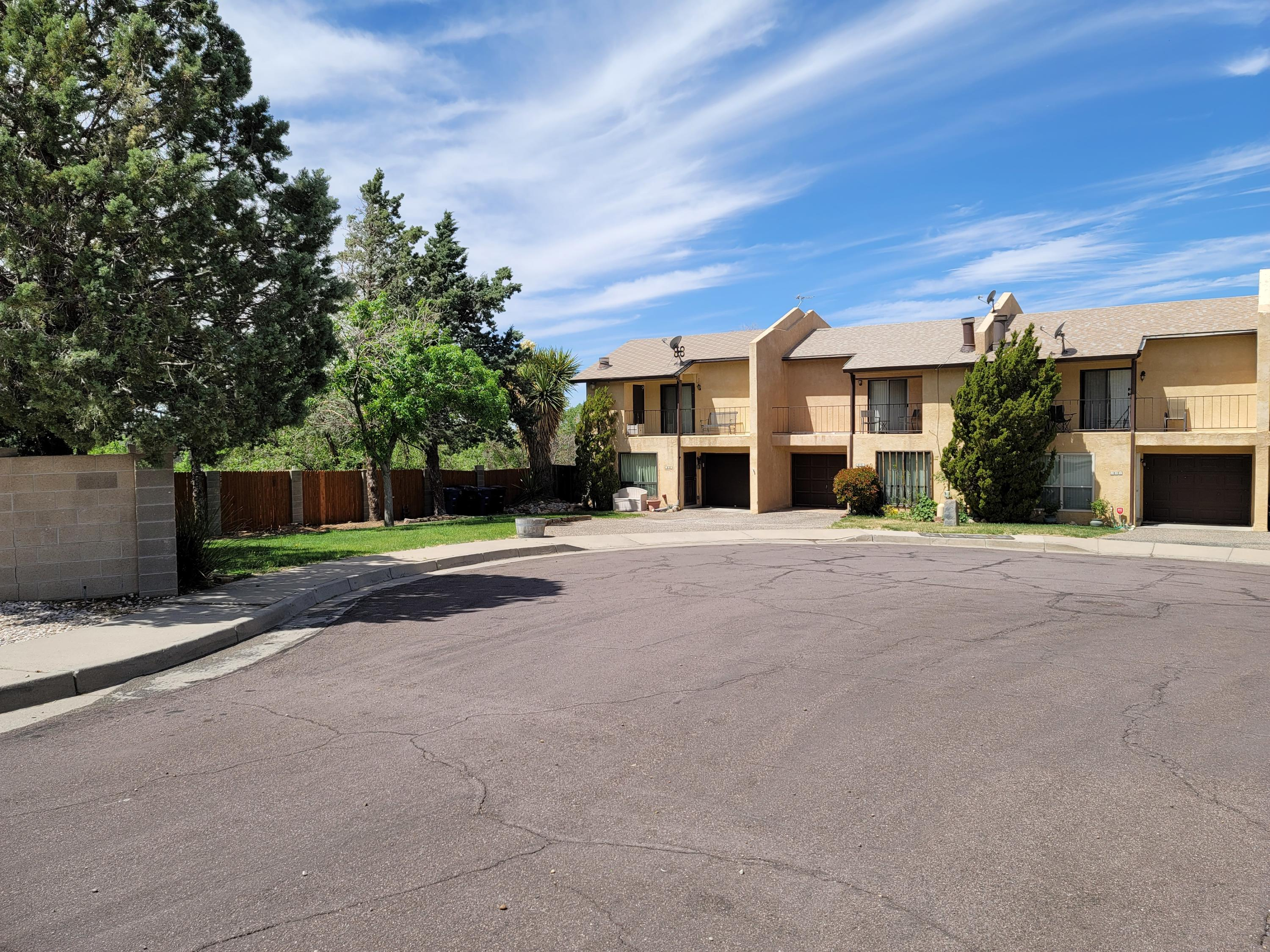 Darling 2 BEDROOM Townhome in the desirable Foothills. Just a hop & skip to I-40. Enjoy the biking / walking trail on Tramway or go for a hike in the foothills.  Conveniently located near Sprouts, Smiths, Movie Theatre and Shopping Center.  Home has Romantic wood-burning fireplace in the corner of the living room for those chilly winter nights. Sip your morning coffee or relax after work on a cool summer evening on either your east or west balcony.  Balconies are off of the 2 upstairs bedrooms.  Low maintenance yards ideal for the busy person.  Please use covid safety practices & wear a mask.