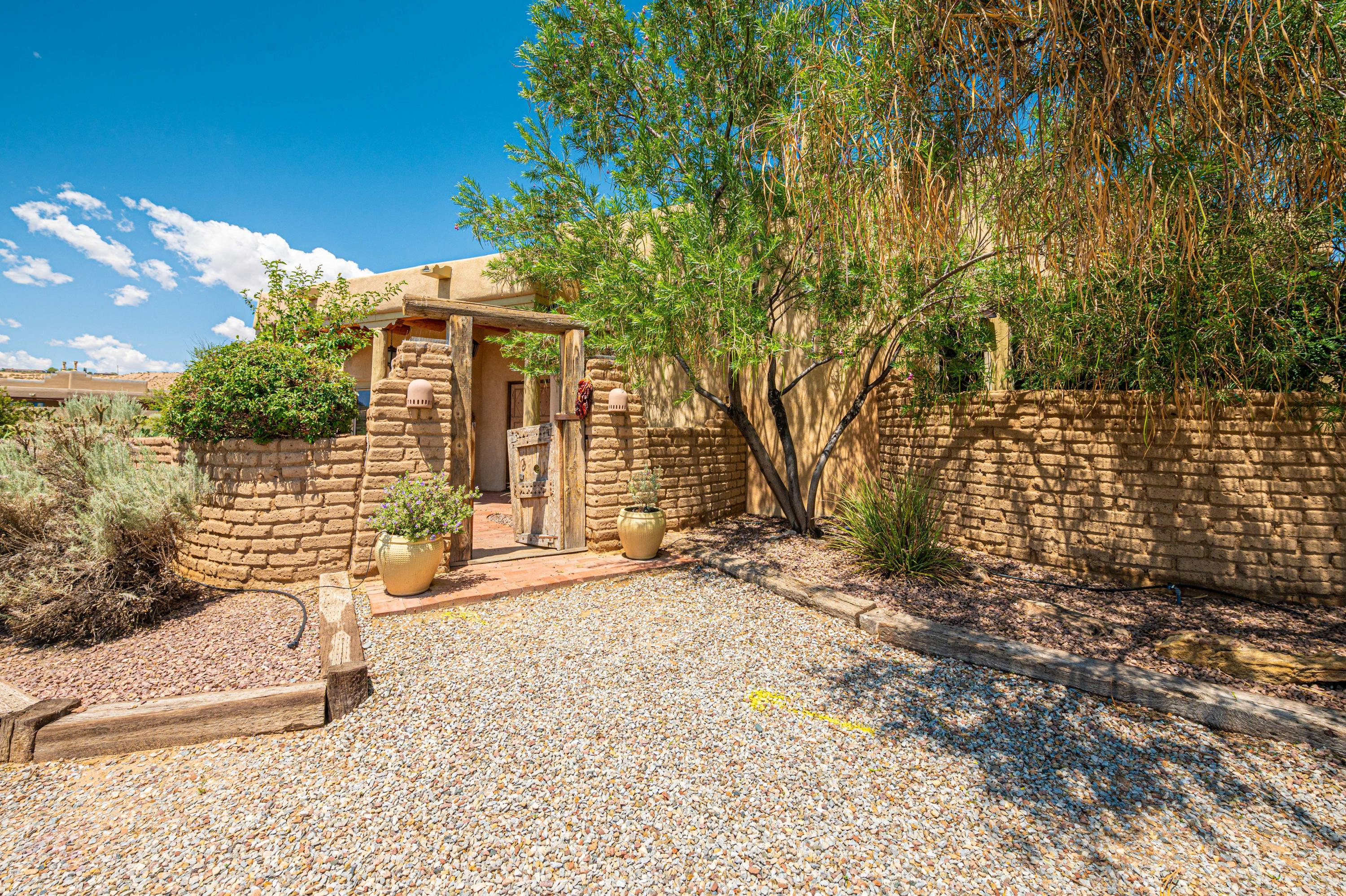 Gorgeous one of a kind home that sits on over and acre of Corrales nature. Stunning views that sweep the entire rear of the home.