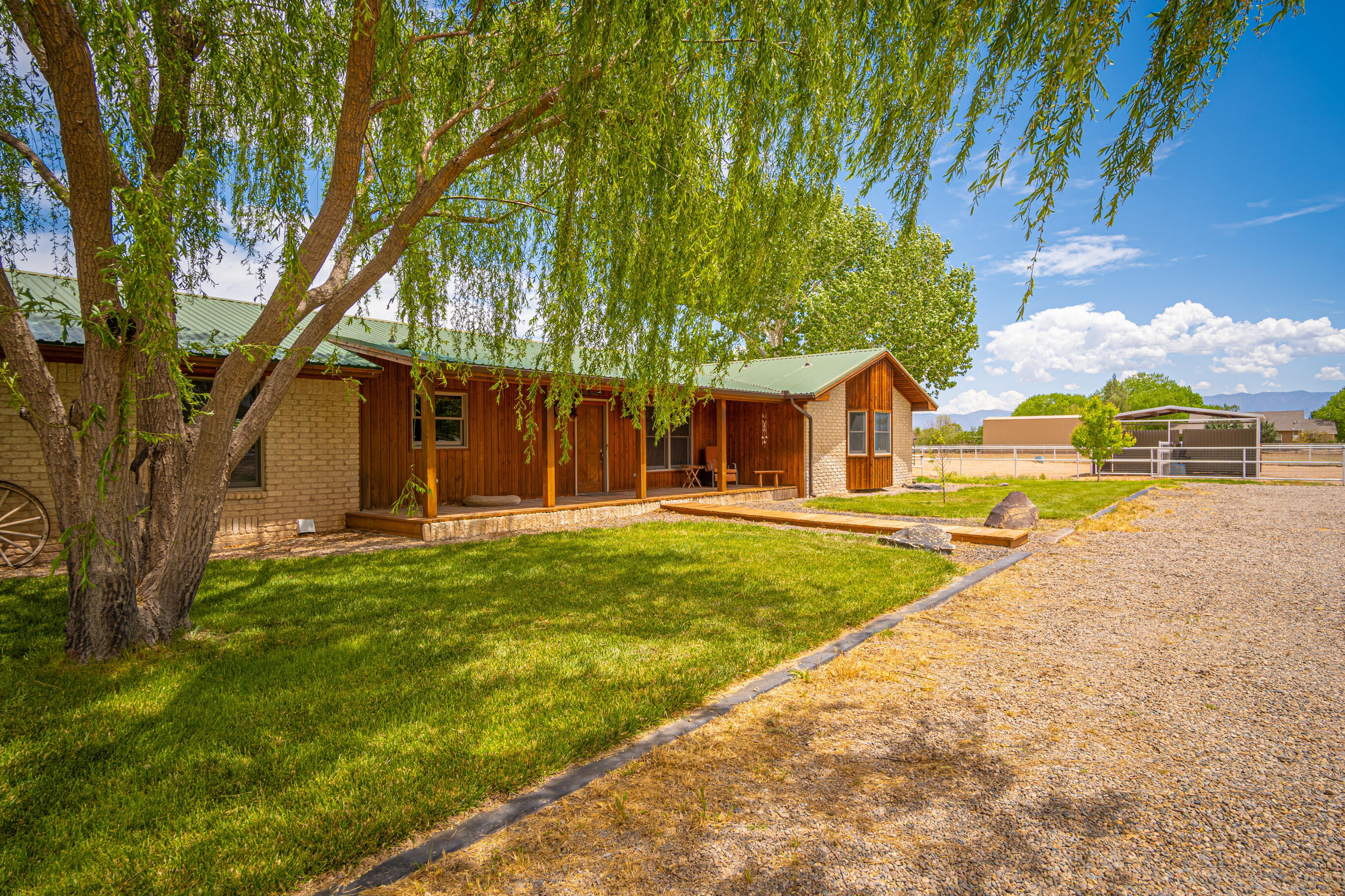 Exceptional horse property on 3 fenced acres. Close to riding trails and the Rio Grande. Beautifully updated, split floorplan, gorgeous open kitchen w/spacious island and custom cabinets. Open floorplan, 2+ large living areas, perfect for entertaining. Master suite has ''spa-like'' bathroom w/large closet. Spacious bedrooms, 2'' wood blinds throughout, tongue and groove beamed ceilings, refrigerated air, HVAC units replaced in 2017, house gutters in 2020, domestic and irrigation Well. Attached 400sq ft tack/saddle room has cedar shiplap walls-could double as home office, hobby room or 4th bdrm. French doors lead to private covered patio with fountain. Outside is a horse lover's playground. Lg barn w/4 stalls, feeders, automatic waters, hay storage, lighting and storage room w/cement floor.