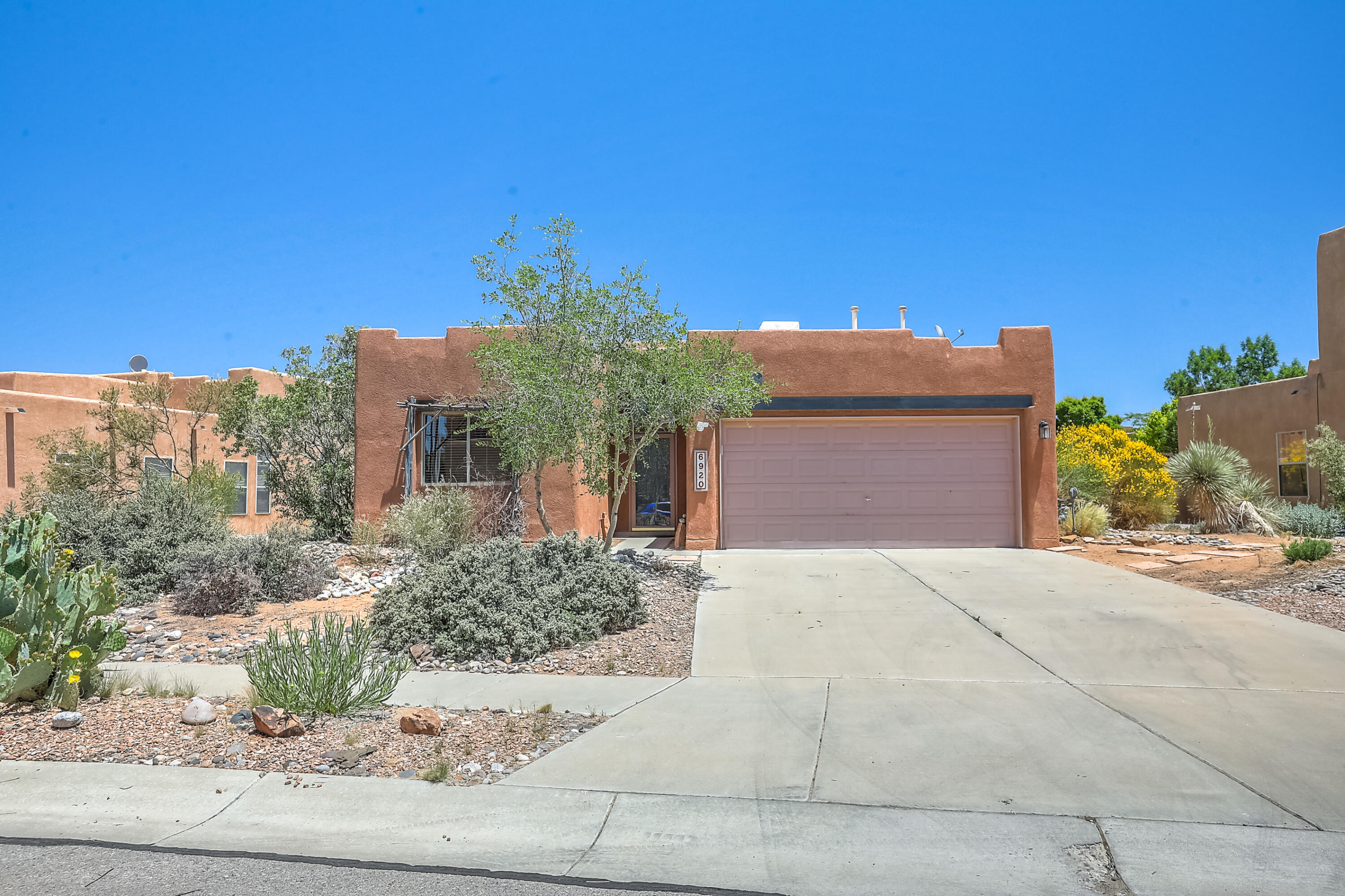 An absolute gem in the Vista Del Norte neighborhood featuring 3 bedrooms and 2 bathrooms with this versatile single-level floor plan. The spacious great room welcomes you with soaring ceilings and a custom gas log kiva fireplace. Enjoy the kitchen with custom cabinetry, SS stove, and dishwasher, accented by a sunny breakfast nook looking onto the patio and backyard. Step into the master suite with soaking tub, separate shower, double sinks, and walk-in closet with built-ins. Beautiful bamboo floors in the master bedroom and guest bedroom. The large and private backyard offers mature landscaping including a fig tree, pomegranate, and beautiful flowering shrubs and cacti throughout or take a short walk to enjoy the neighborhood park and playground. New roof installed 5/2021!