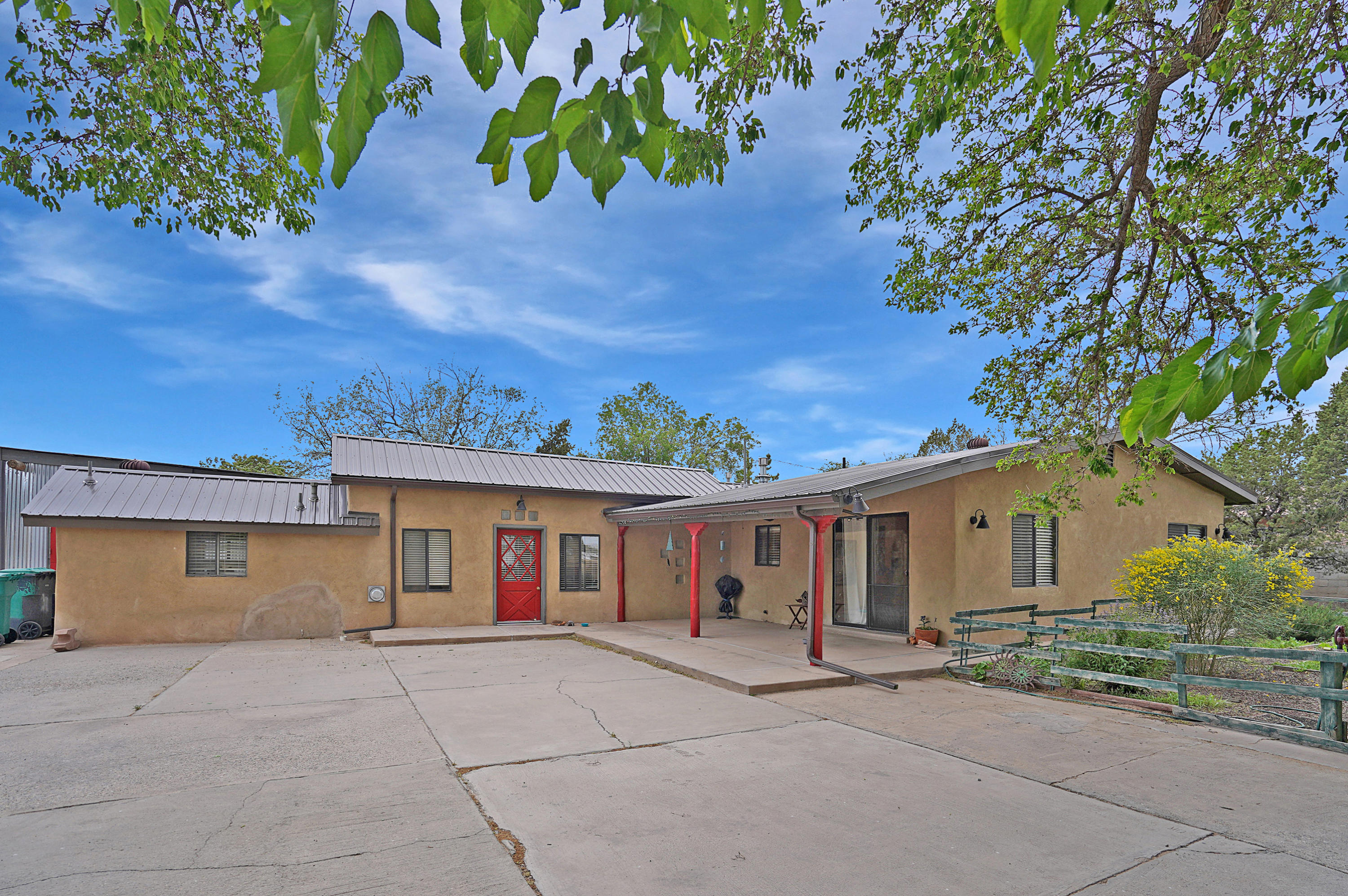 Discover this hidden gem in the heart of the North Valley! Enter the private road to a gated, secluded property with acreage and views! Plenty of space for horses and toys. The main house is surrounded by beautiful greenery. The kitchen has its own entrance and stainless steel appliances. The living area has artisan crafted designs with cove ceilings. Bathrooms are spacious and service room is huge! Barn/Garage has plenty of space for vehicles and tools. The private courtyard is perfect for retreating and enjoying the gentle summer breeze. Rest under the covered patio of the separate casita which features its own full kitchen and garden tub! Property has Irrigation Rights from MRGCD