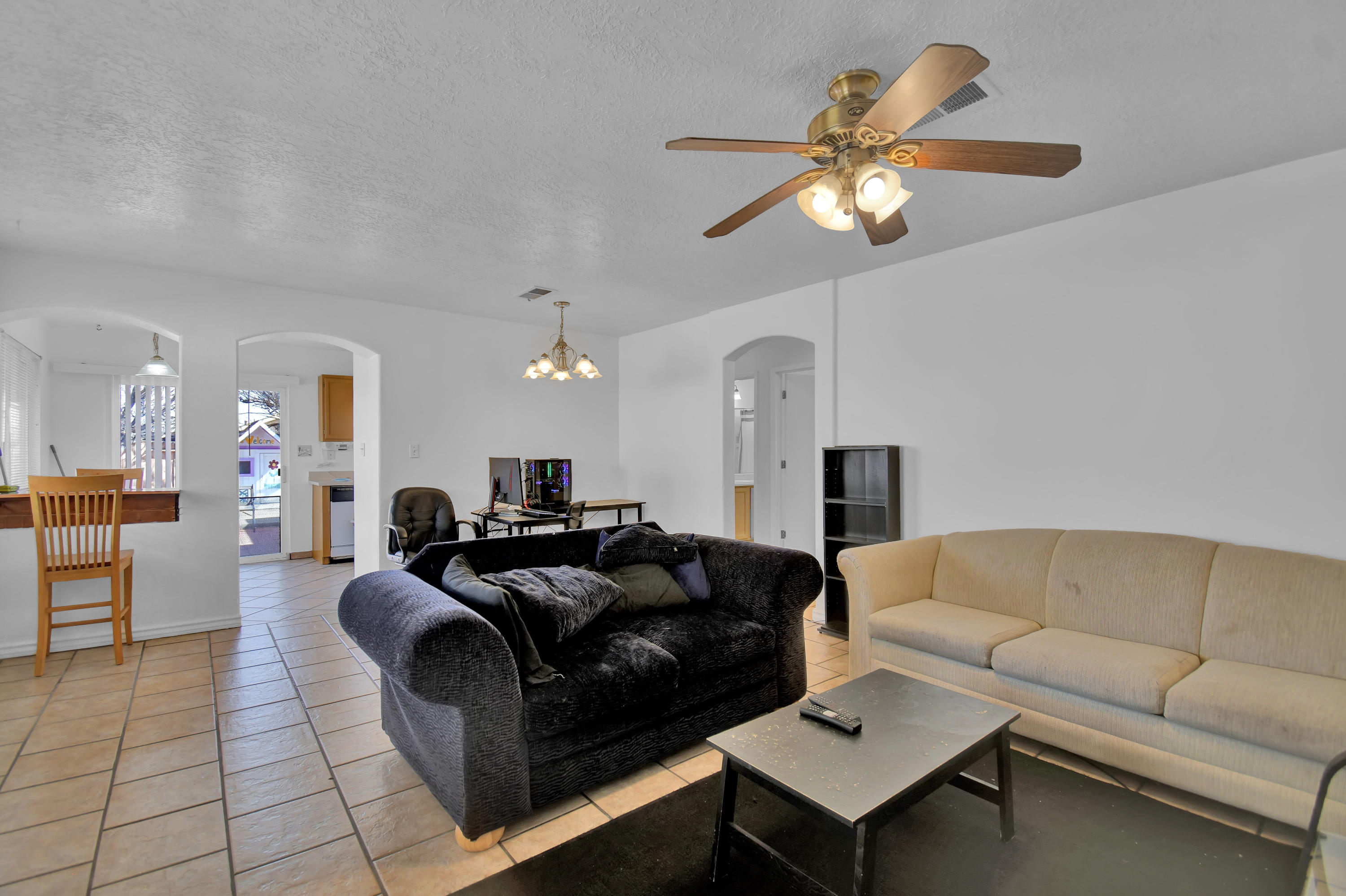 Cute 3 bedroom, 2 bath home with brand new roof in the south valley ready for its next owner! Wide open great room with tile flooring. The kitchen is compact and efficient with a nice breakfast bar. All bedrooms are good-sized with roomy closets. The backyard is large and fenced for privacy and includes a built in spot for the outdoor grill master! Nice big trees with the potential to provide the perfect amount of shade on a sunny Albuquerque afternoon. Most rooms newly painted except for the master bedroom and the back room. Water heater is only two years old and swamp cooler only 3 years old. Come see this one today!