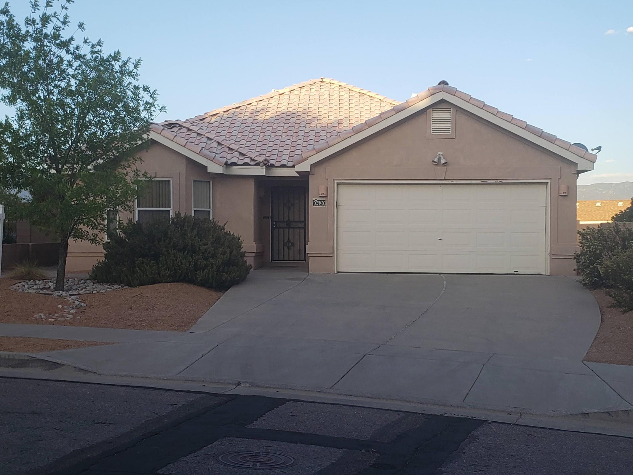 Great open floor plan, with Cathedral ceilings.  Kitchen includes a breakfast nook  and separate dining room.  Tile in all wet areas. Privacy wall in backyard with East facing patio, SW Xeriscape.  Awesome Flagstone fire pit, no maintenance Real Turf Grass.  Refrigerated air. Back on the market.