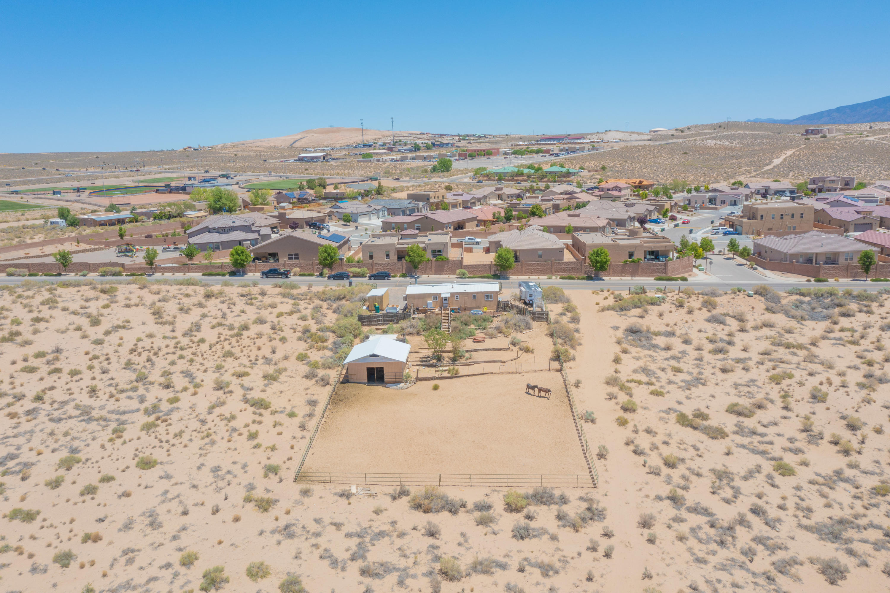 Rarely available 5 acre parcel with cute mobile home on A-R (Agricultural Residential) zoned land in Rio Rancho!  This property consists of 2 side by side parcels that are 2.457 acres and 2.544 acres respectively.  Mobile home is currently assessed as personal property.  Utilities are in including a well, septic tank, gas and electricity.  A barn with water and a corral are on the property as well.....bring your horses!  Permissive uses include Raising of nursery products, Agricultural activity, Churches, and more!  Come check out this unique and private property today!