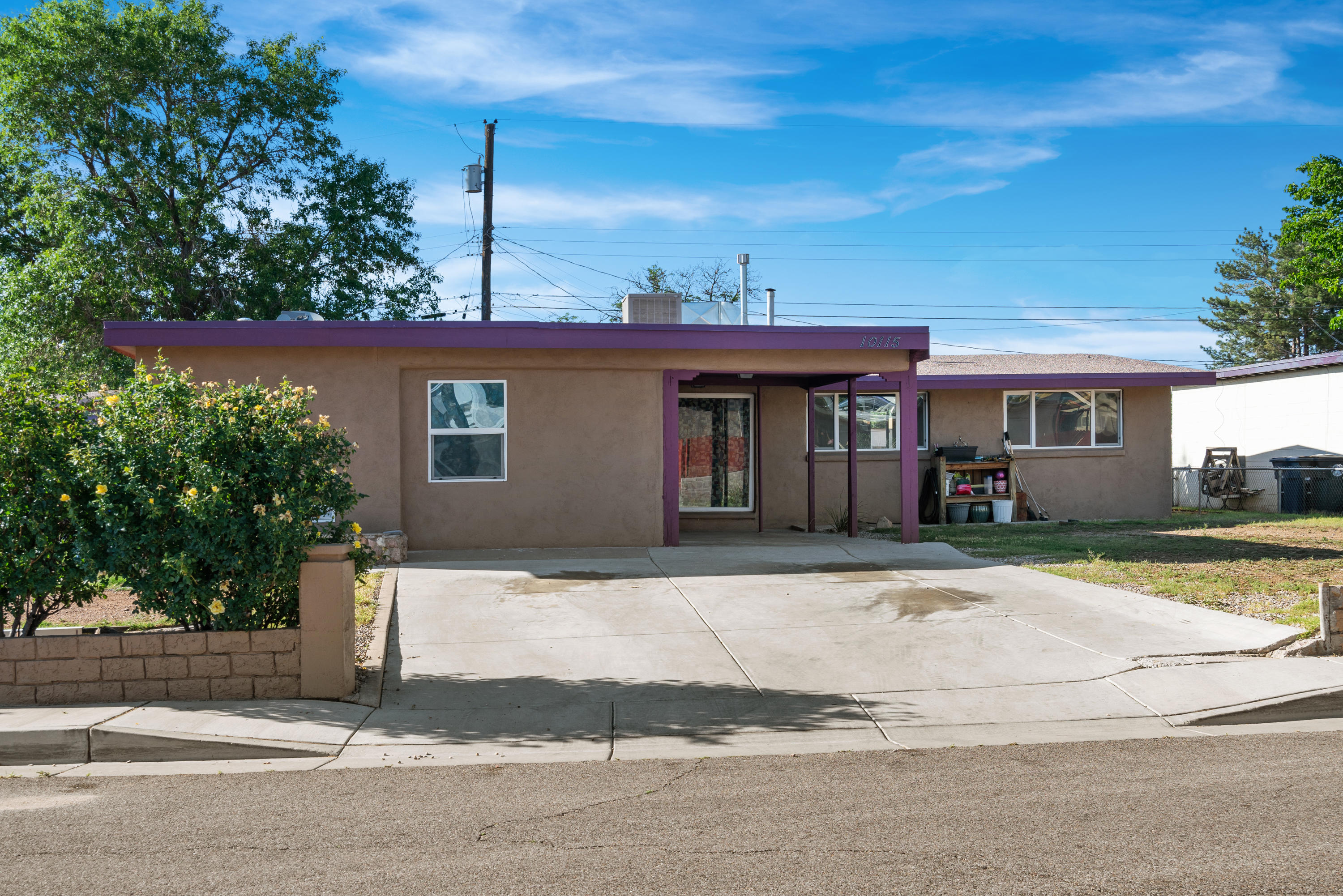 BACK ON MARKET. 4 bedroom, 2 bath home featuring a central living room alongside a cozy den with traditional wood-burning fireplace. Brand new carpet placed in all 4 bedrooms as of June 1st. The ample master bedroom with walk-in closet is on the opposite side of the house from the other 3 bedrooms. Kitchen features granite countertops and is directly adjacent to separate dining room. Large front yard with established rose bushes. Prime location, convenient and close to schools, shopping centers, and parks. Direct backyard access to arroyo with walking and biking trails.