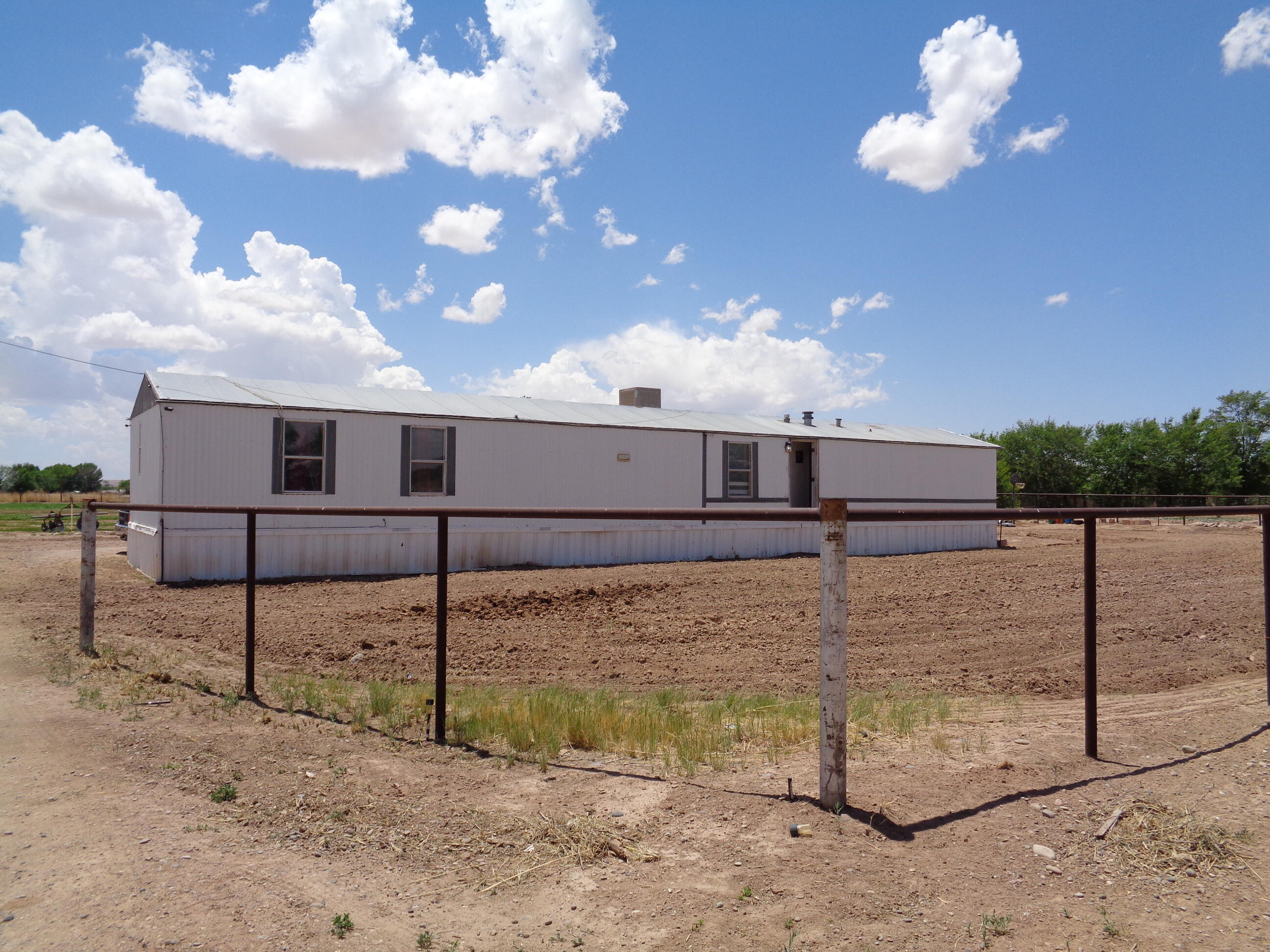 Located in a wonderful valley setting with 3 bedroom, 2 bath single-wide manufactued home on 3.98 acres.  Home has wood laminate flooring in the living, kitchen and dining area.  Split master suite.  Property is cut into 4 lots; 3.12 acres are ditch irrigated.  Also includes UPCs 1007034488478000000, 1007034500476000000 and 1007034510475000000.