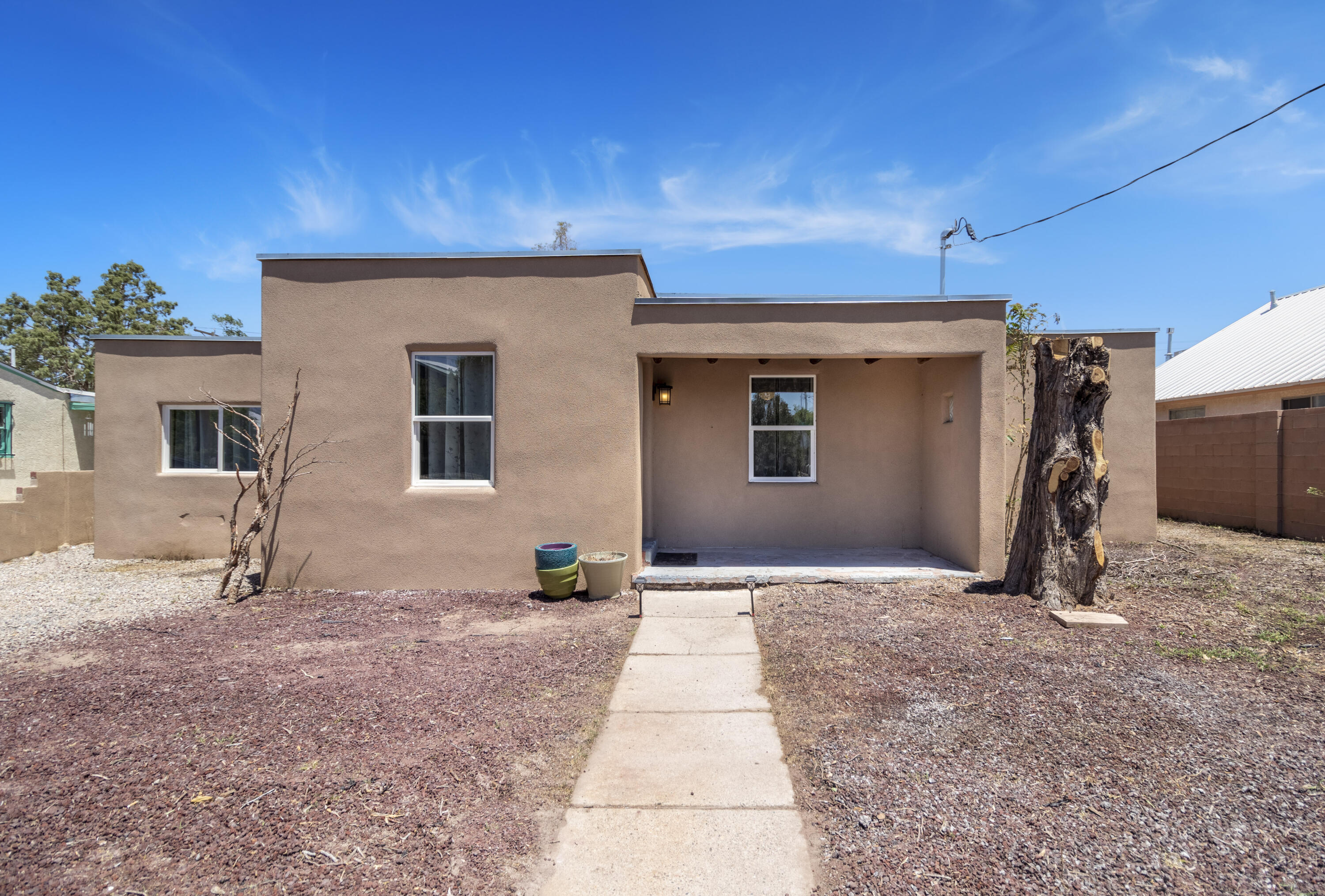 An absolutely darling 2bdrm home situated in a great North Valley location. This home offers two living areas and an updated kitchen with granite countertops, gorgeous backsplash and stainless steel appliances to include a built in microwave and side by side refrigerator. Updated bath.  Some beautiful hardwood flooring, tile and carpet, and  thermal windows. An amazingly spacious backyard with storage shed.  Easy access to both I-40 and I-25, Shopping, Restaurants and entertainment.  Great home! This one won't last long.