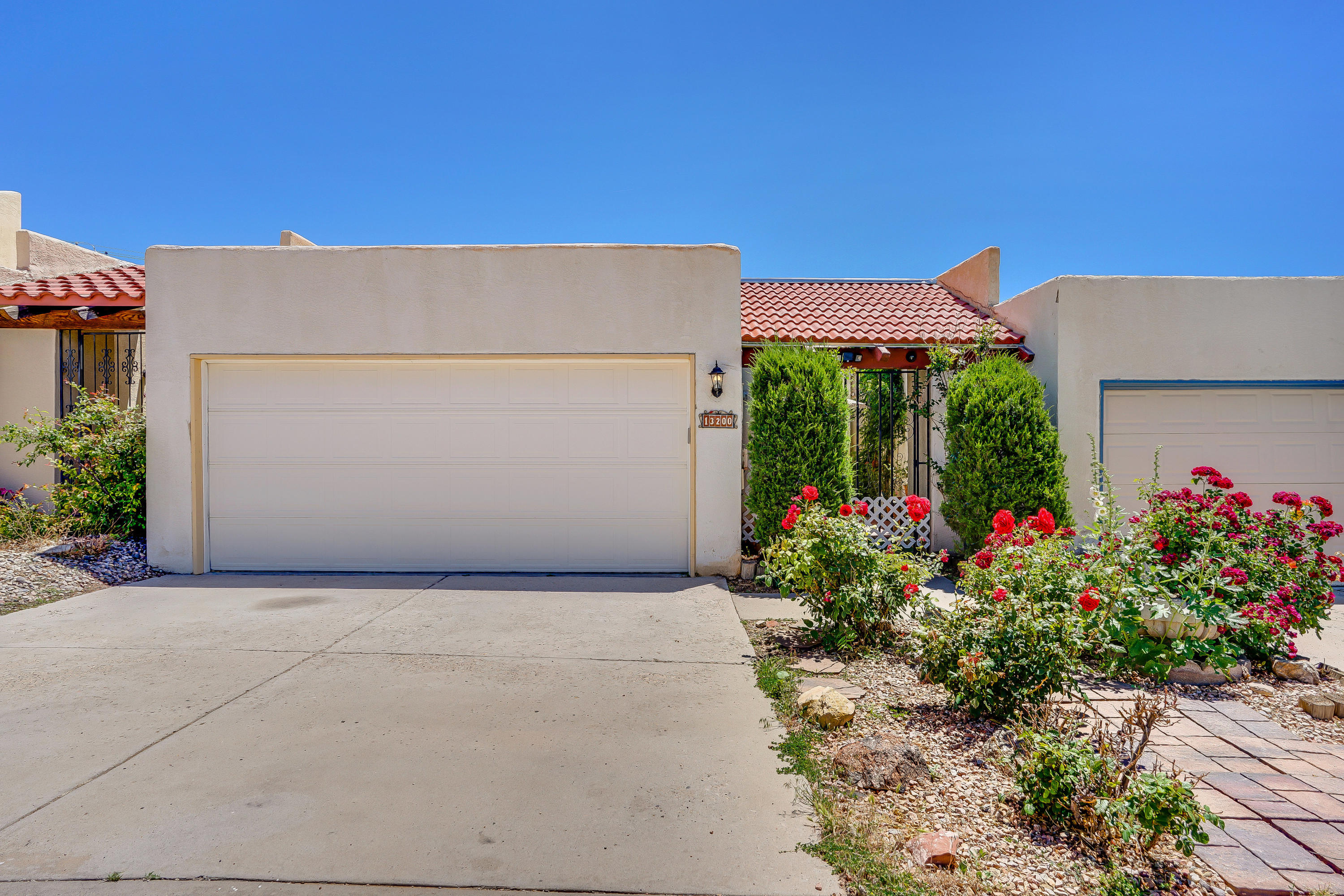 Charming, must-see townhome located near the foothills!  You will feel right at home with the open floor plan, cozy fireplace, updated flooring and relaxing low-maintenance yard. Skylights allow for natural light to flow into the living room, kitchen, and bathrooms! The kitchen features a breakfast bar, gas range, white cabinets, and plenty of counter space! Enjoy your morning cup of coffee in the attached sunroom. There is a small backyard space to enjoy a small garden or room to soak up some sun! Two-car garage and private courtyard entrance! Not to mention a brand new roof and swamp cooler that is only 1 year old.  Take a virtual walkthrough tour today! All offers will be reviewed Sunday 6/6 at 6 pm. Down payment assistance available through Bank of America - ask your agent how.