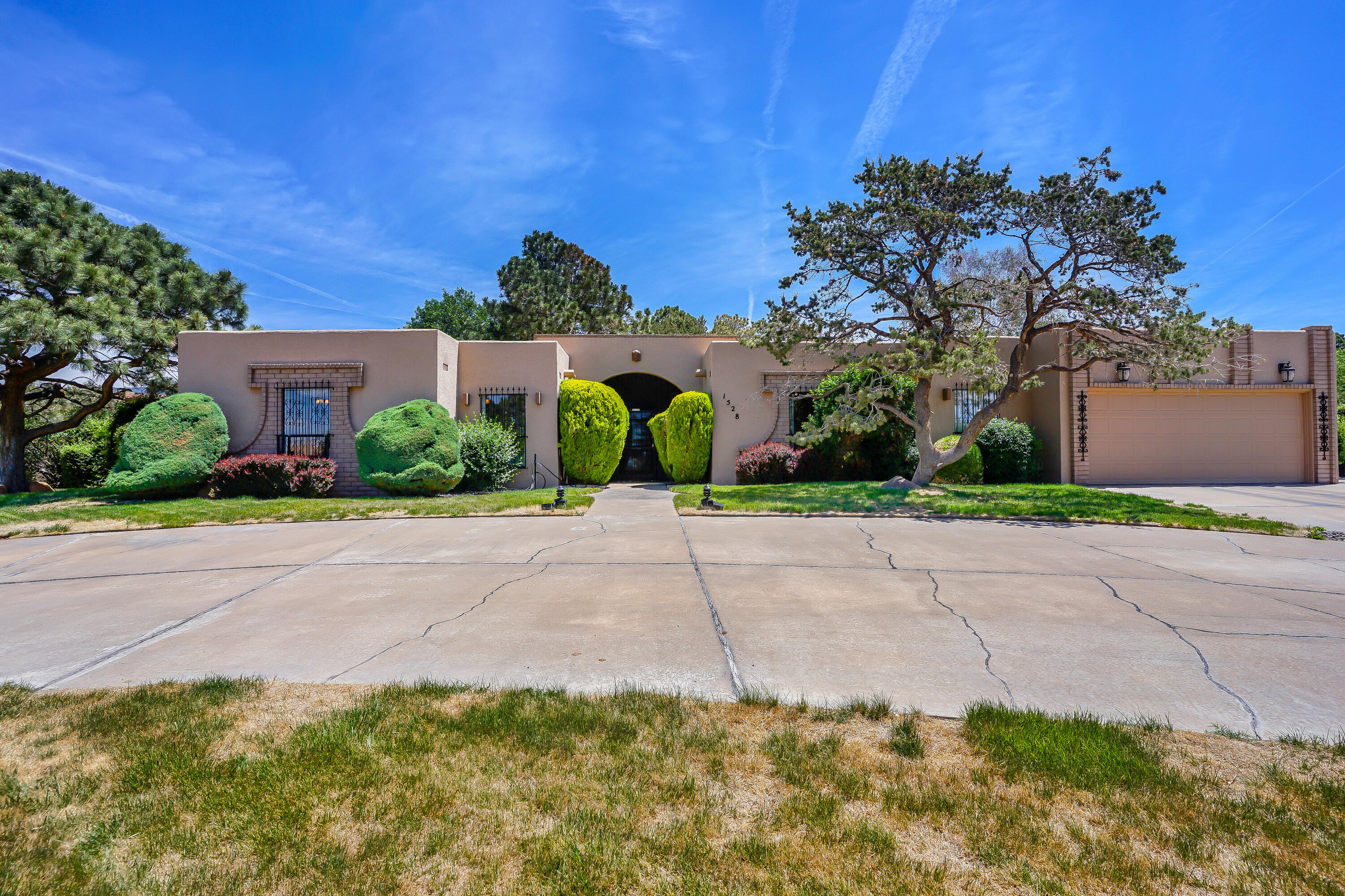 Don't miss this gem! Beautiful, well-kept 4 bedroom, 3 bath home located in the Four Hills neighborhood. Conveniently located near the freeway & shopping, this home offers 2 living areas, a large stone face fireplace, gorgeous kitchen with custom cabinets with plenty of storage & spacious bedrooms. Entertain in the lush backyard under the large covered patio. Make an appointment to see it today!