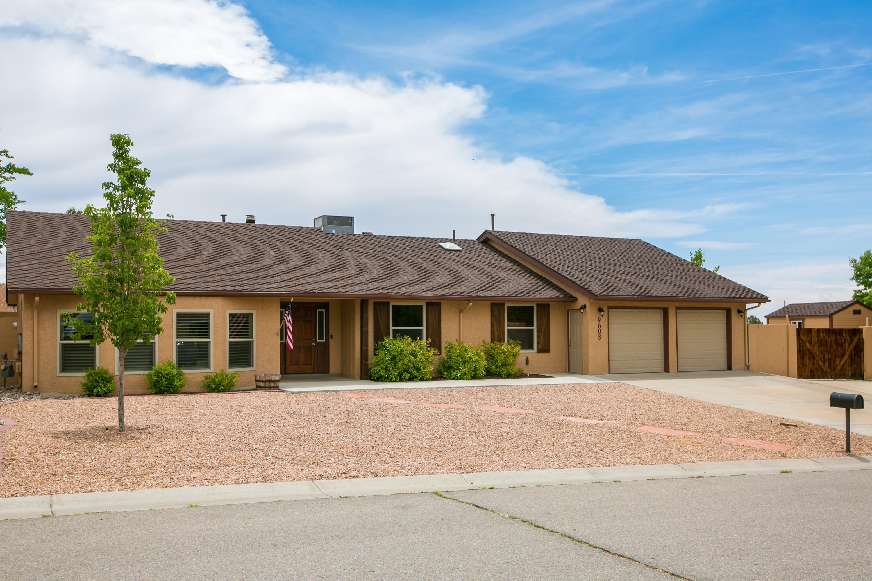 Don't miss this fully renovated NE ABQ ranch style home on a quiet cul-de-sac.  This 3 BR, 2 BA, 2,174 SF home features warm touches including wood laminate floors, shiplap accent walls, wood blinds, sliding barn doors & brick fireplace. Stylish updated kitchen offers stainless appliances, large pantry w/additional storage.  Exceptionally large primary bedroom with private bathroom suite, his & her closets, separate AC/heating, & French-door access to an outdoor patio.  Entertain family & friends outside on the several patio areas, grass yard/garden area & a spiral staircase leading up to a observation deck with stunning mountain and city views.  Plenty of room for toys in the 2-car garage & RV parking area.  Additional updates include central air, new roof (2019), electrical panel, stucco