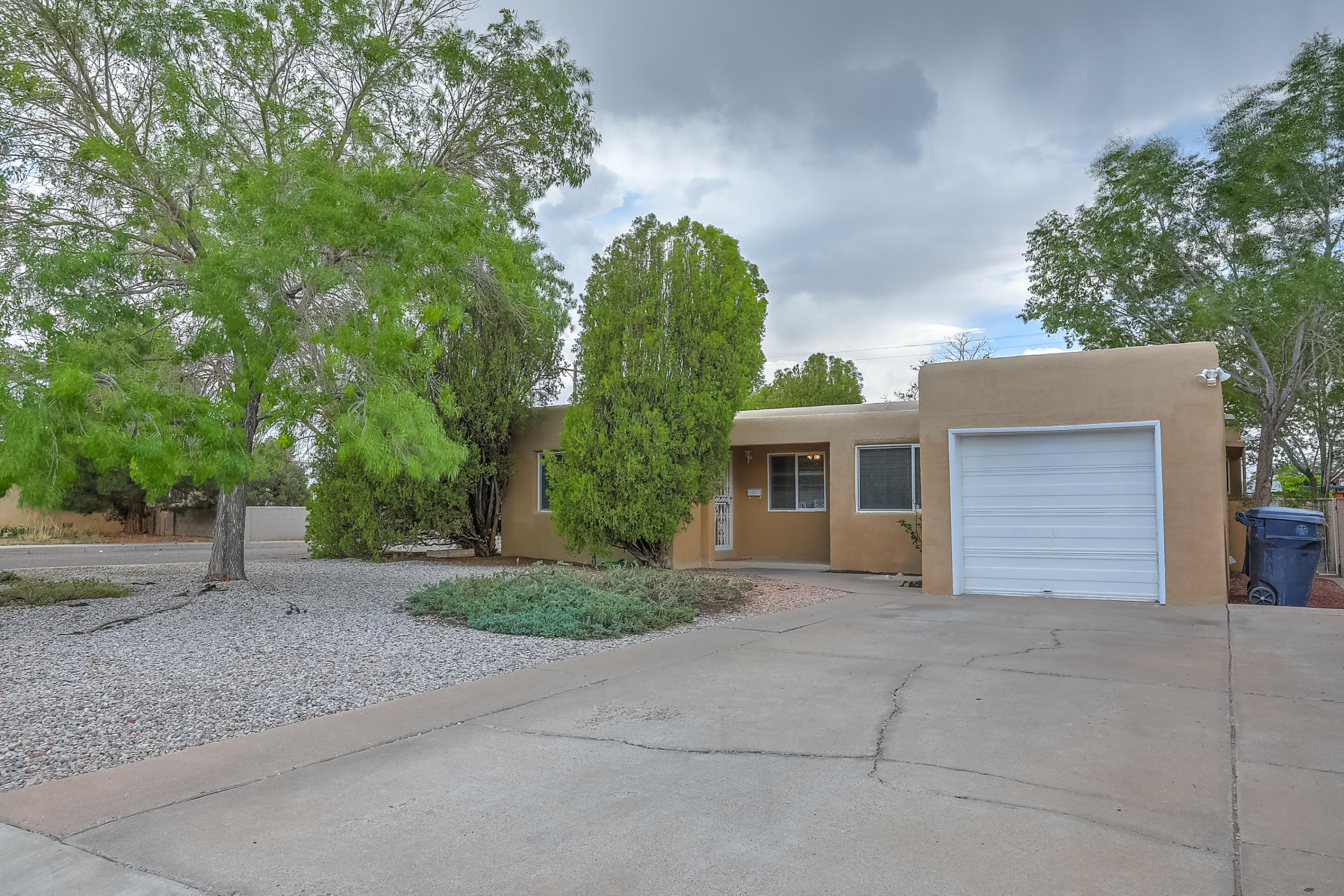 This property is centrally located to Uptown, Sandia National Labs, Kirtland AFB, UNM, and has easy access to I-40.Many updates to include newer carpet 10/20 and Kenmore dishwasher 03/21, newer electrical upgrade 04/21, roof maintenance and parapets 08/20, newer compressor in air conditioner 06/16, and newer trenchless main sewer line and cleanouts from house to sidewalk 06/18.  This floorplan has two living areas / formal dining, plus breakfast, 3 bedrooms, 2 full baths and a 3/4 bath, and two of the bedrooms counting the master bedroom have walk-in closets, with the master's being a cedar closet. There are arched doorways in living room and dining and a sunny and bright kitchen that any chef would want to cook in.