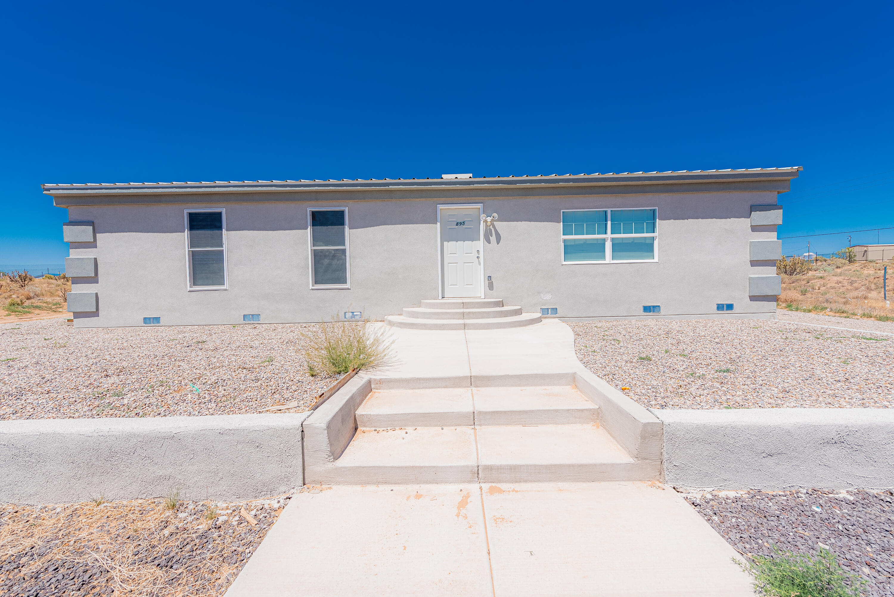 Beautifully renovated manufactured home on .50 acres lot! Newer roof, new floors, updated kitchen, new tankless water heater, updated bathrooms, new electrical wiring and stucco! Appliances convey, don't miss out on this opportunity!