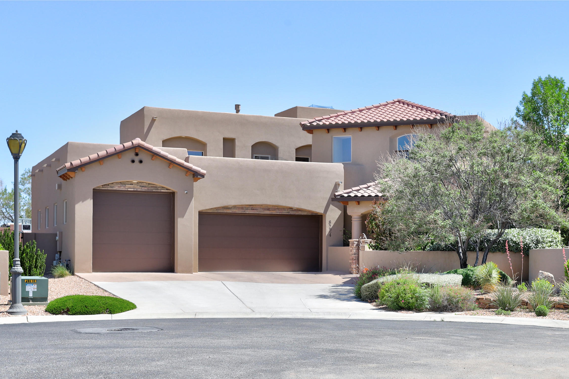 Stunning custom home in a gated community on a cul-de-sac in exclusive NE enclave!  Gorgeous outdoor spaces replete with expansive covered patio, in-ground pool & spa and views of the Sandias! Spacious open floorplan is graced by exquisite finishes. Radiant heat + gas CFA  & Refrigerated air for year round comfort! Arched oversized wood door leads to grand foyer with 2-story ceiling, custom tile, spiral staircase and Juliet balcony.  Raised ceilings and open concept make this spectacular dream kitchen feel airy and accessible with 2 convection ovens + microwave/oven combo, 5-burner gas range, KitchenAid side by side refrigerator/freezer, deluxe pantry, a large island and a  large scale breakfast area.  The kitchen boasts a second pantry for wholesale shoppers. .   (more.