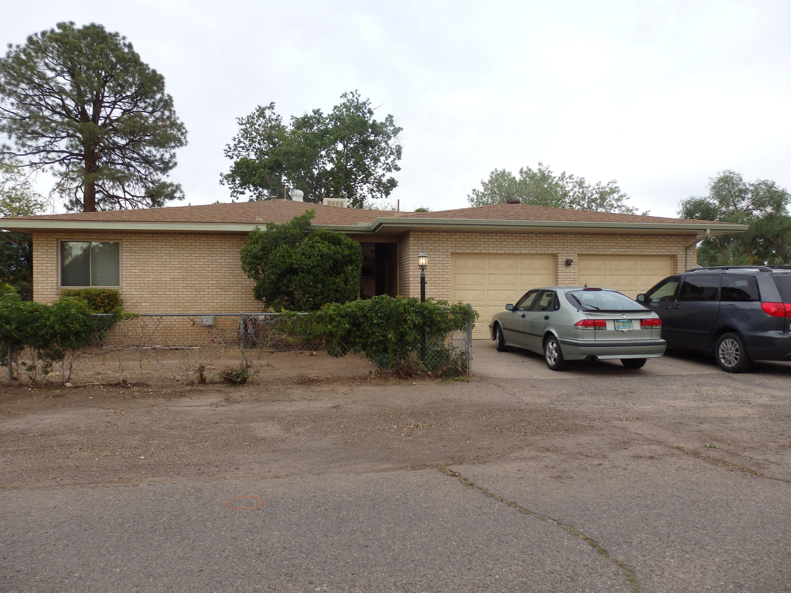New Price. Large price reduction. Brick Ranch Style on almost a half acre corner lot in Los Ranchos. Ideal for bringing your Big Toys. Green house. Recent re roof, gutter system and soffitts.  Great family home in a delightful family area.