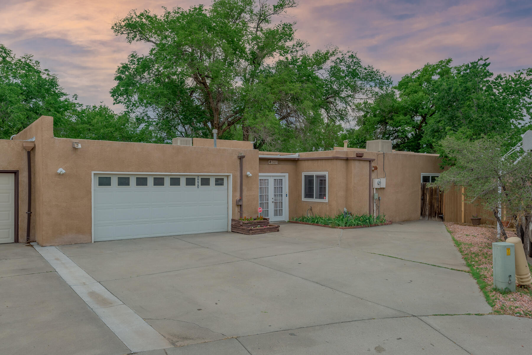 Wonderful gem in the North Valley!  Lots of potential in this desirable Montano Village central location! Newer Modern Windows, Newer Luxury wood/tile flooring, elevated wood beam ceilings, Possible 4th Bedroom or hobby room , plant or sunroom/sewing room,  Updated galley-style Kitchen opens to elegant Formal Dining concept,  Large family room accompanied with lovely Fireplace for winter nights.  Lots of storage & closet space. Fancy wet bar area for entertaining, French doors to Master has slider to outdoor living space. Wall divider near FP creates study . Endless possibilities!   Private Patios & 114 sq footage of storage rooms for your toys, gardening equipment. 2 New Coolers, year old TPO Roof, New H2O & heat unit , private patio space 2 entertain !Master/Fresh paint , No Hoa or PID