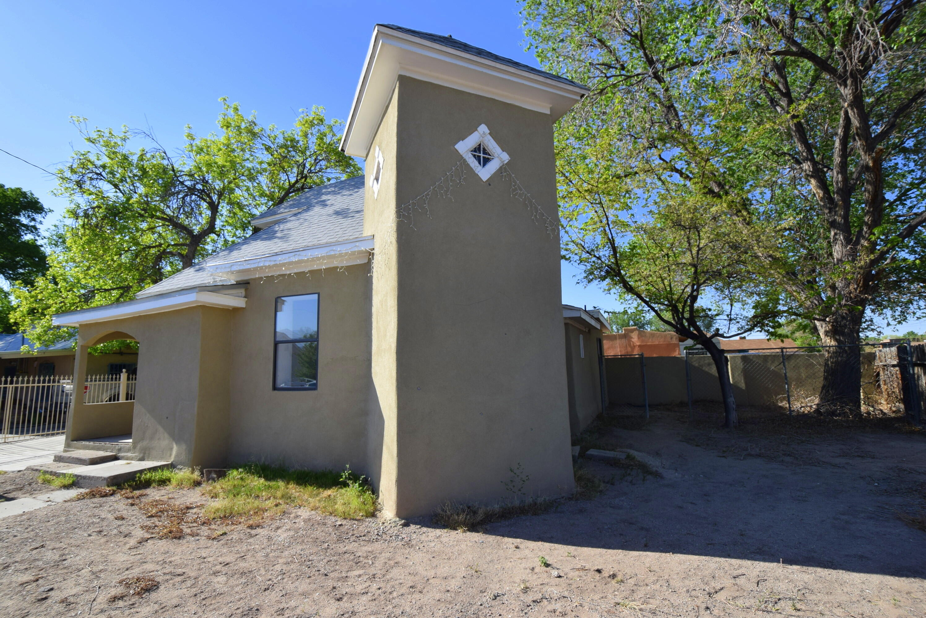 This unique property reflects the style and grandeur of the Barelas area.  Built during the heyday of the Railroad discovering Albuquerque and the village growing into a city.  It reflects the creativity of the time with it's adobe style and open and welcoming areas.  Freshly painted, flooring repaired and building will be re-stuccoed.  There is a small Casa in back where your friends can stay as the enjoy all the fun the city has to offer.  Walking distance to the National Hispanic Cultural Center, historic Barelas Coffee House and all the Downtown recreation.  Easy access to bus and transportation hubs with main roads far enough so you don't hear the traffic but can get to anywhere quickly. You know - Albuquerque has more FUN days per year than any other city in the civilized world!