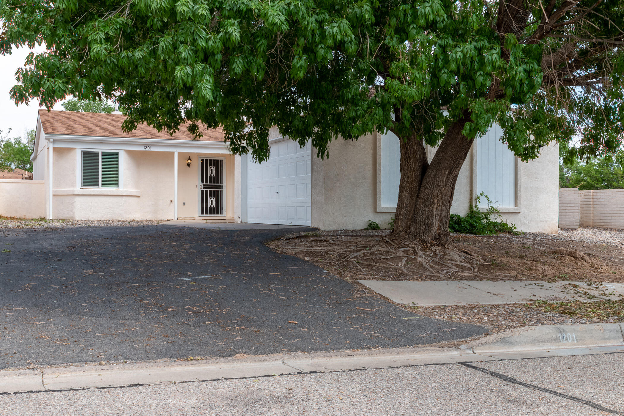 So many recent updates in this feature rich home! Come take a look at this 2 Bedroom, 1 Bath, Large 2 Car Garage home on a big corner lot! Tile throughout except the 2 Bedrooms.  Re-Piped (No poly). Some of the many updates from 2018 include Roof, Water Heater, Furnace, Windows, Front Door, Garage Opener, Light Fixtures, Hardware, Kitchen Countertops, Cabinets, Backsplash, Dishwasher, Microwave, Gas Range, Refrigerator, Carpeting, Bath Tub, Vanity, Dual Flush Toilet, Interior and Exterior Paint, Window Blinds and more.  Easy living floor plan, great color scheme. This one is ready to call home!