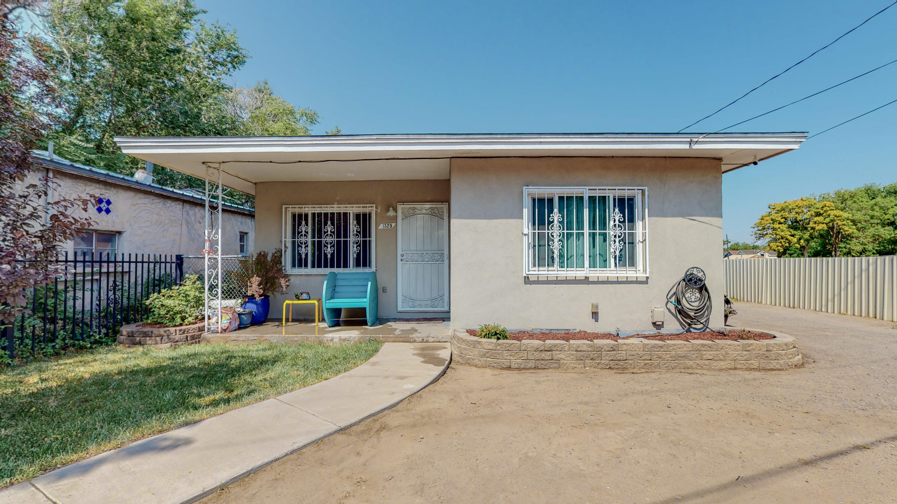 This property has been updated with a beautiful kitchen, entire home has matching tile, 2 tankless water heaters installed in 2019, 2018 new electrical panel, 2016 new AC refrigerated units.  Back garage converted to a insulate workshop with electricity and can be easily turned in to a casita/in law quarters.  Front gate is electric for easy access.