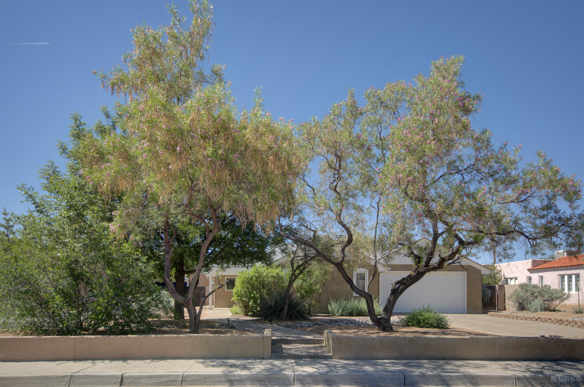 This demands very little of you but gives you so much starting from the picture perfect condition. Young home for Ridgecrest built in 1989 on a quiet street...Quality construction with oversized rooms. Clearstory windows create light & airy feeling heightened by oversized glass windows to bring the outside in. The dining room handles a 10 foot table with even room to grow. Tile and hardwood floors throughout the home. Counterspace that just keeps going and tons of cabinets with pull outs .This custom home has supersized closets & storage that you dream about. Anderson wood windows combining energy efficiency & style with air lock doors & passive solar. Out building could be a studio or office it's approx 323  not included in square feet. Att: you must see this 2 car garage...wow