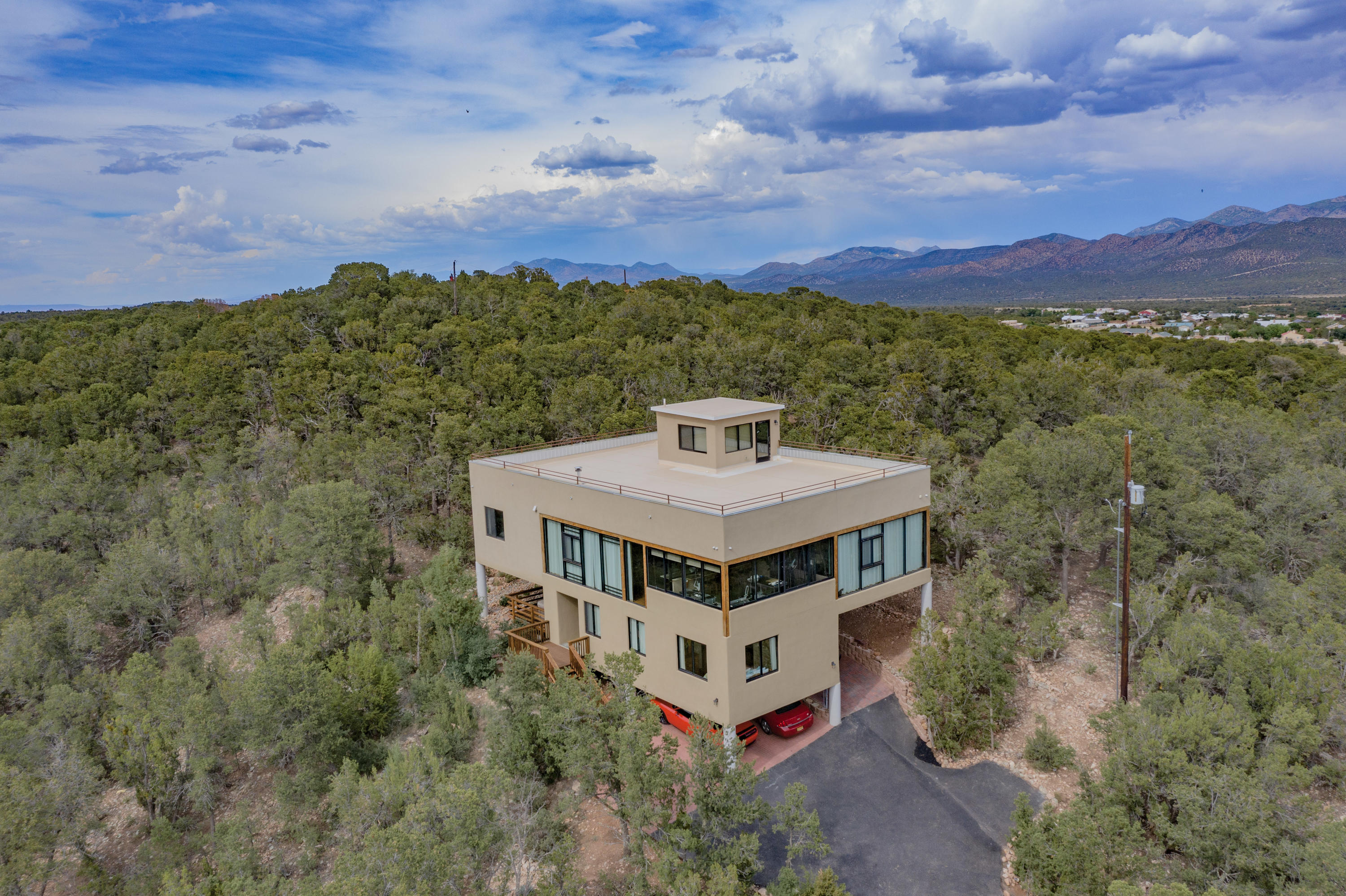 Custom 3 story luxury home on 1 acre in Sandia Park. Hardwood floors and tile throughout. 3 exterior decks, hot tub and sauna for those lovely mountain evenings. Plaster walls, enclosed outdoor kitchen with plenty of seating. Four bedrooms , each with their own bath. 3rd floor reading room/ office is a private sanctuary. Views? Views, Views, Views!