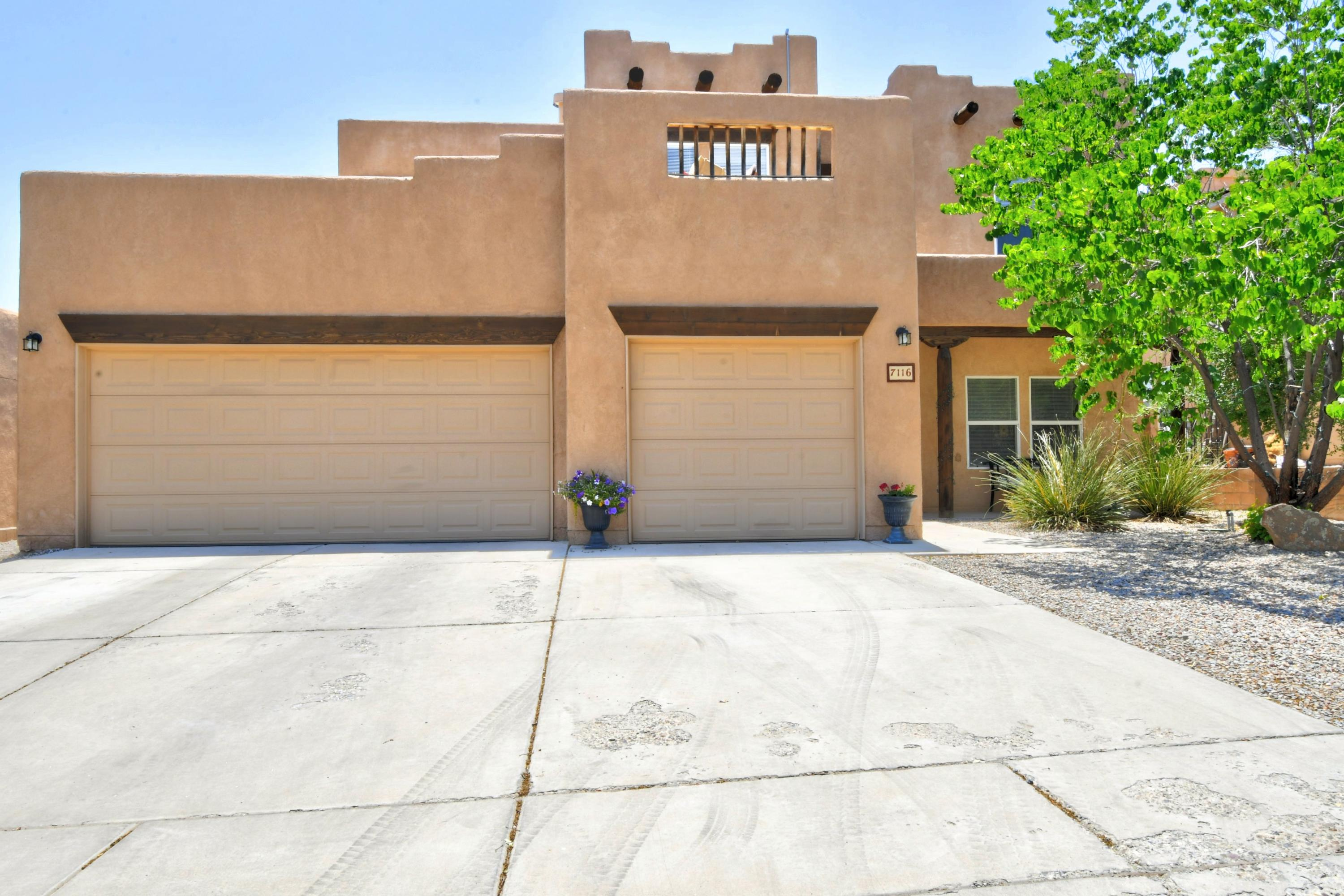 Located in the safe, gated community of Reserve at the Trails, this spectacular 5 bedroom home boasts a wide open floor plan. The kitchen contains ample cabinet space and a beautiful full set of appliances. Lots of counter space with bar top and breakfast nook. Main level contains guest bedroom and full bathroom. Exposed vigas and high ceilings give this gorgeous home it's desirable Pueblo style. Second level offers 4 more bedrooms and a spacious office/family room. A south facing deck provides views of the vast New Mexico skyline. Owner's suite contains spacious walk-in closet and a large full bathroom with separate shower and jetted tub. Updated carpet in upstairs bedrooms and hallways give a warm, comfy feel. Solar panels help offset the electric cost of the 2 refrigerated air units.