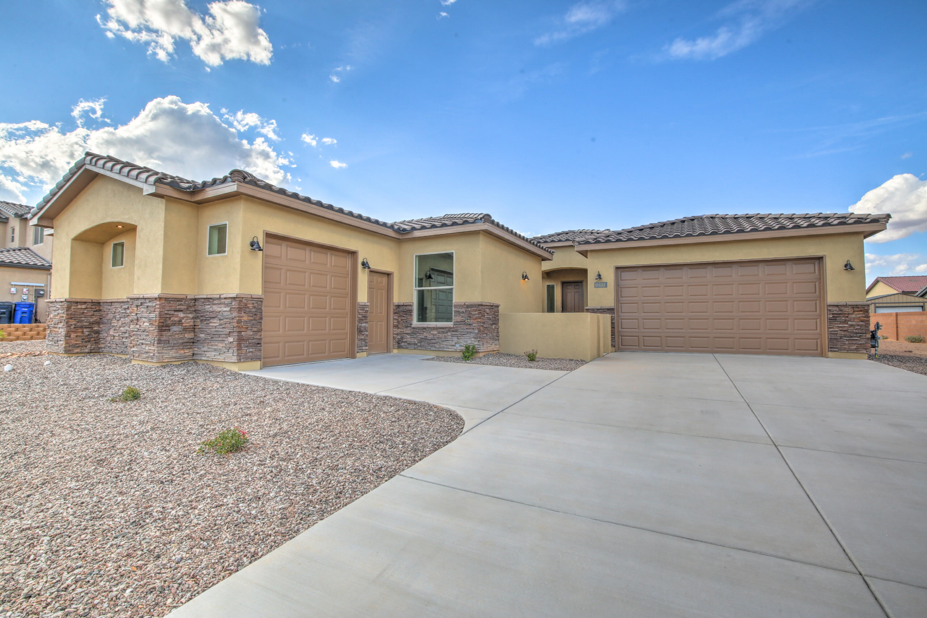 Beautiful new construction in the heart of the Petroglyphs. This open floor plan is four bedroom, two and a half bath, with a three car garage.  Home is currently under construction.  It will come with a dishwasher, refrigerator, microwave, and gas range stove.   Please contact the listing broker to view.