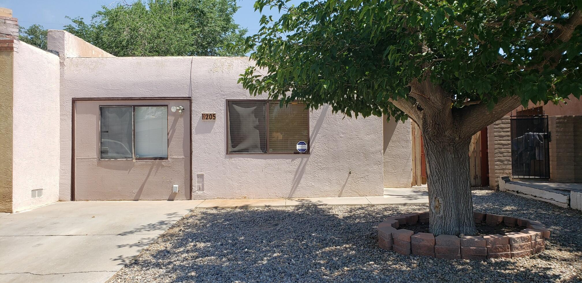 Cheaper than Rent! This  spacious 3 Bedroom, 2 Bathroom Town Home is centrally located in the North Valley. Tile and Laminate Flooring throughout. Spacious Kitchen with Bar which has enough space for 3 to 4 Barstools. The Pellet Stove that comes with the Home nicely heats the open Kitchen, Dining and Living Room areas. There is a sizable Back Yard for those cookouts and also has a large dog run along the side of the house. All Appliances are included. No HOA. Seller offers $1,000 towards paint or closing costs with acceptable offer. Selling as is. Make an appointment with your Realtor today.