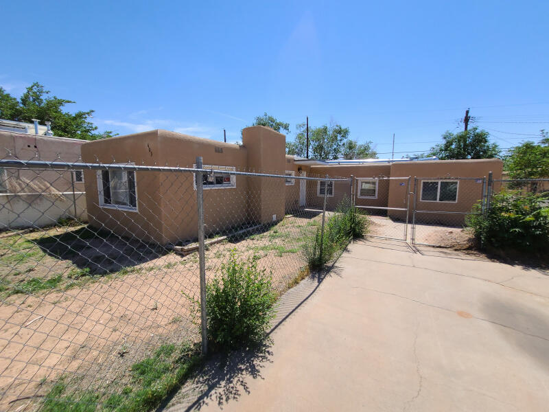 Fixer upper!  Great Opportunity for the investor or handy person.  Huge living area with fireplace, fenced yard and nice kitchen. The home needs some work including roof repairs, flooring, plumbing, missing some fixtures but great potential.  Easy access to fairgrounds, freeway and uptown!