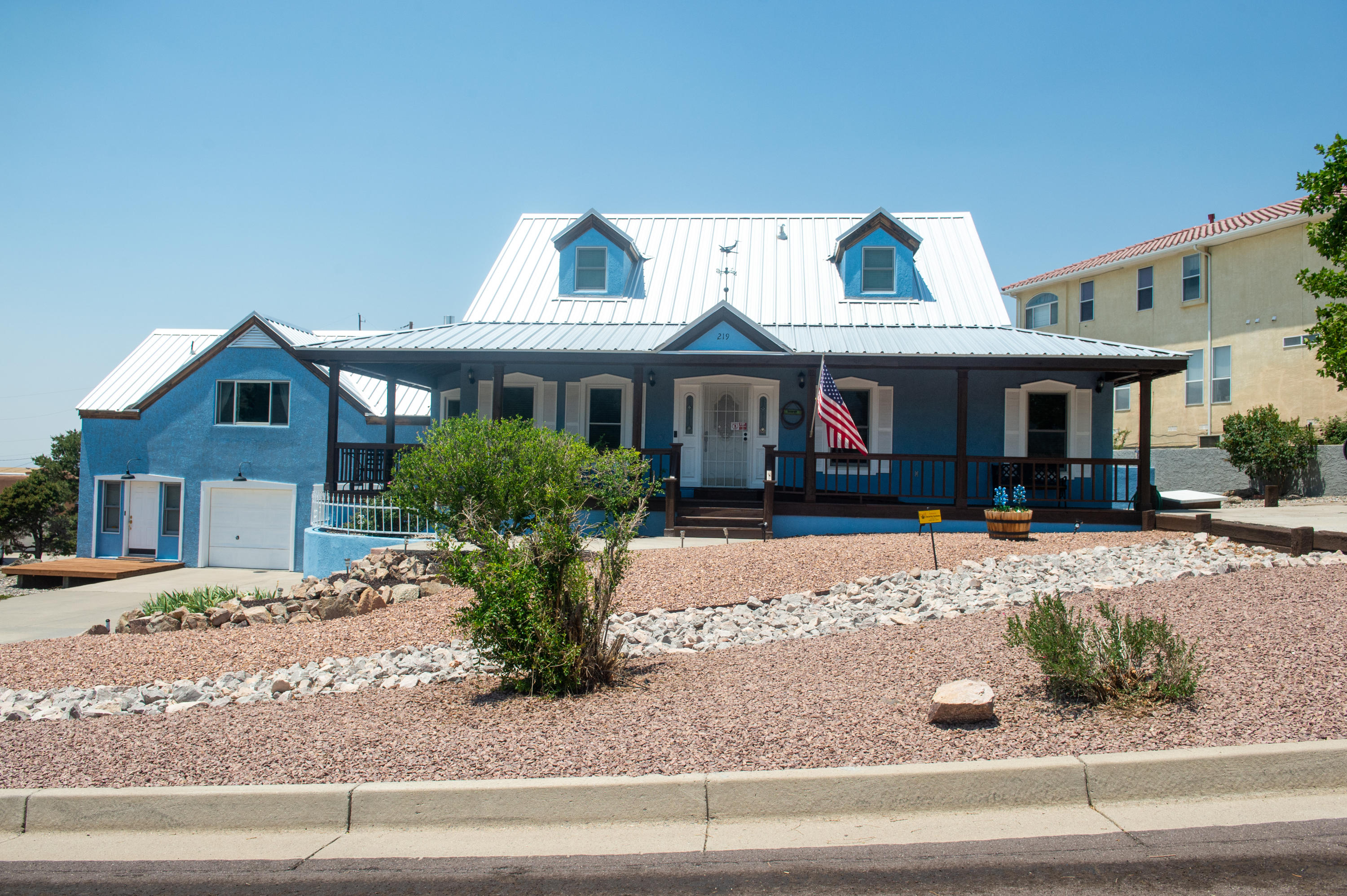 Situated at the base of 365 trailhead, this house is ''more nature than neighbors''... with all the amenities and ready access to Albuquerque! Enjoy beautiful views from covered porches in the front and the back. This home has been meticulously cared for and it shows! The kitchen is beautifully updated. You'll be charmed by the brick floors. The secondary bedrooms are ideally situated away from the main bedroom. Fourth room and a full bath attached to the opposite side of the garage makes for a great studio or a workspace. Abundant storage like you've never seen!  Don't miss the storage rooms behind the upstair closets-- complete with flooring and electricity! Almost an entire car bay worth of extra storage in the garage. Timeless beauty! This house is love at first sight!