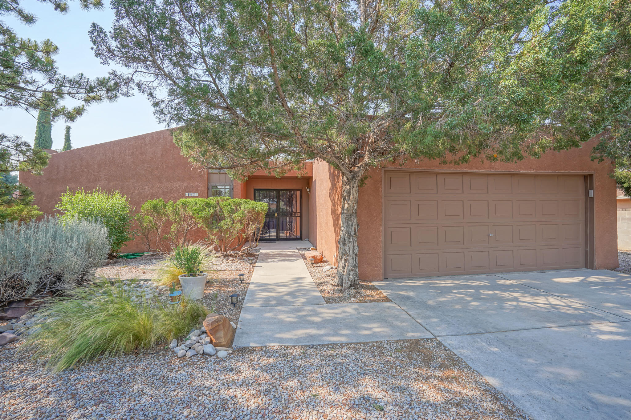Beautiful Taylor Ranch home in a quiet neighborhood. Located within a short distance to great shopping, schools, parks and the Bosque River Trails. Abundant natural light with many windows, high ceilings and a center atrium that opens to the entry and living area. Four bedrooms, with separate master/bath, open concept dining and kitchen area. Owners have invested over $65,000 in home improvements inside and out.  Improvements inside include a complete kitchen remodel, bathroom remodels, new paint and trim throughout, solid core doors, closet refinishing and shelving.   Kitchen includes quartz countertops and all stainless steel appliances, with modern lighting, open design and bar seating area.