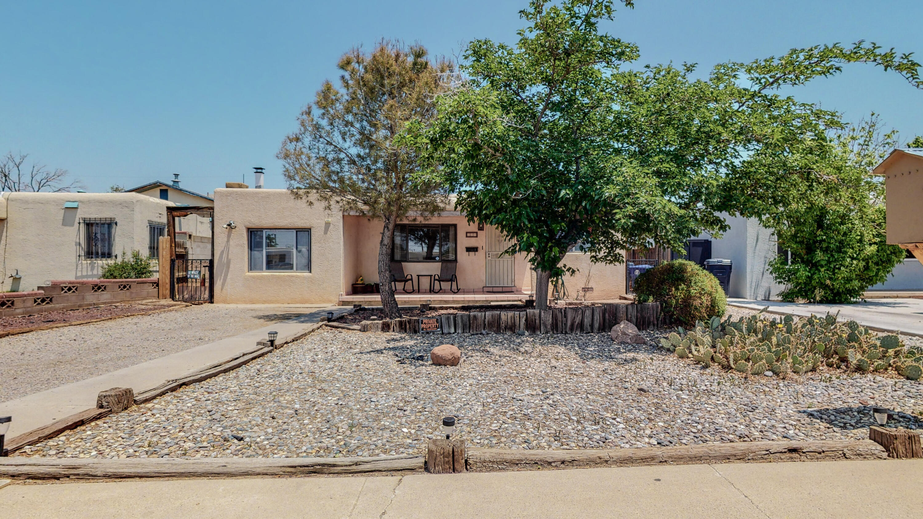 What a charmer!  Sip tea on your front porch as you enjoy the quiet block and lovely xeriscaped front yard.  Inside of this cutie, you'll find a spacious living room with hardwood floors and a step-down den with a custom wood-burning fireplace. Off the den is a dining area with plenty of storage and access to the big backyard.  Back inside is an adorable, bright kitchen with stainless steel appliances.  Two good-sized bedrooms and a full bath complete this home.  Great starter home!