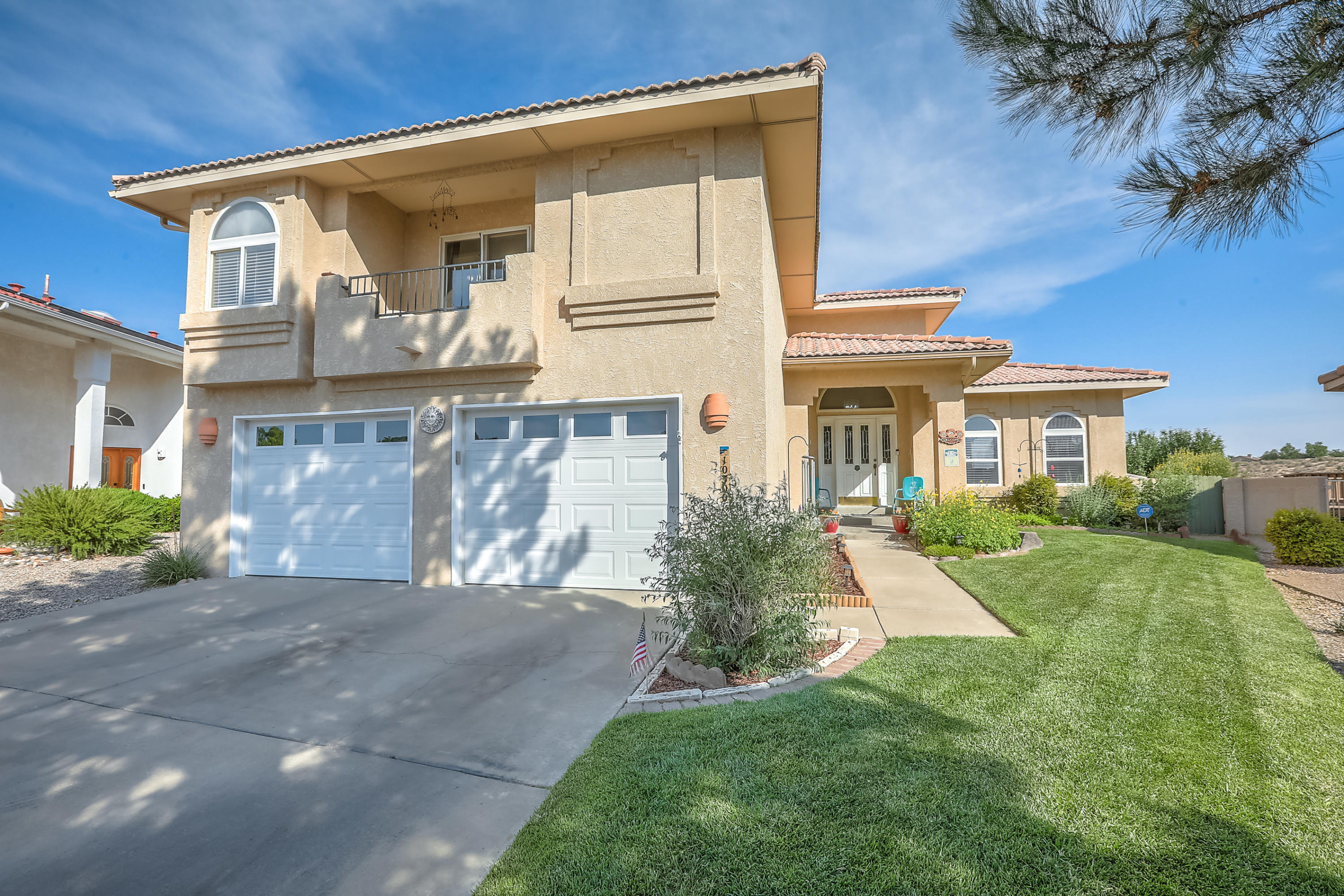 This exceptional, well-maintained semi-custom Mock home offers everything a homeowner could ever want. LOCATION - tucked into the corner of the Hunters Run neighborhood, backing up to the neighborhood park, walking distance to 7 Bar Elementary and Cibola High Schools, moments away from Cottonwood Mall, Lowe's, Home Depot, Costco and other retail services, restaurants, Lovelace Hospital, medical services, and more.  VIEWS - unobstructed and panoramic views of the Sandia and Manzano mountains by day, and beautiful City lights by night.  QUALITY CONSTRUCTION - 2 x 6 construction, tile roof, oversized 2-car garage, extended rear patio and wonderfully landscaped front and rear yards.  LIVABILITY - thoughtfully designed floorplan opens to a formal living room and dining room, bright open kitchen