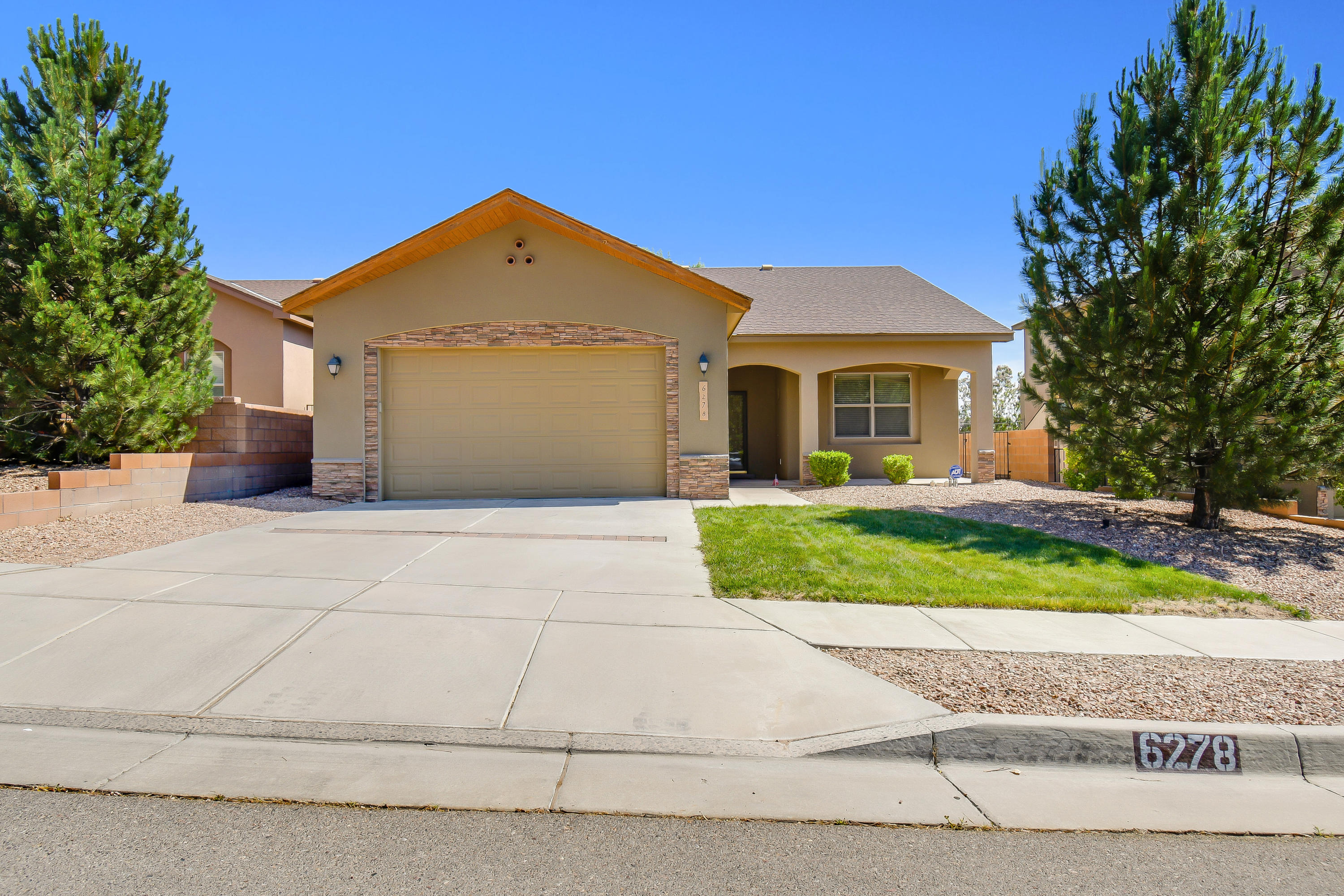 This beautiful NM Green built Paul Allen home is ready for a new owner! Right in the desirable Saltillo neighborhood. Home has a cozy fireplace that turns on with the flip of a switch for those colder nights! In the summer the private backyard, with lots of shade from trees and a covered patio is ready for you to enjoy. The dog run on the west side of the house is ready and waiting for your best friend.  Green build and Energy Star appliances  (like the tankless water heater) means lower bills!!! Stop by to see it before it's gone!
