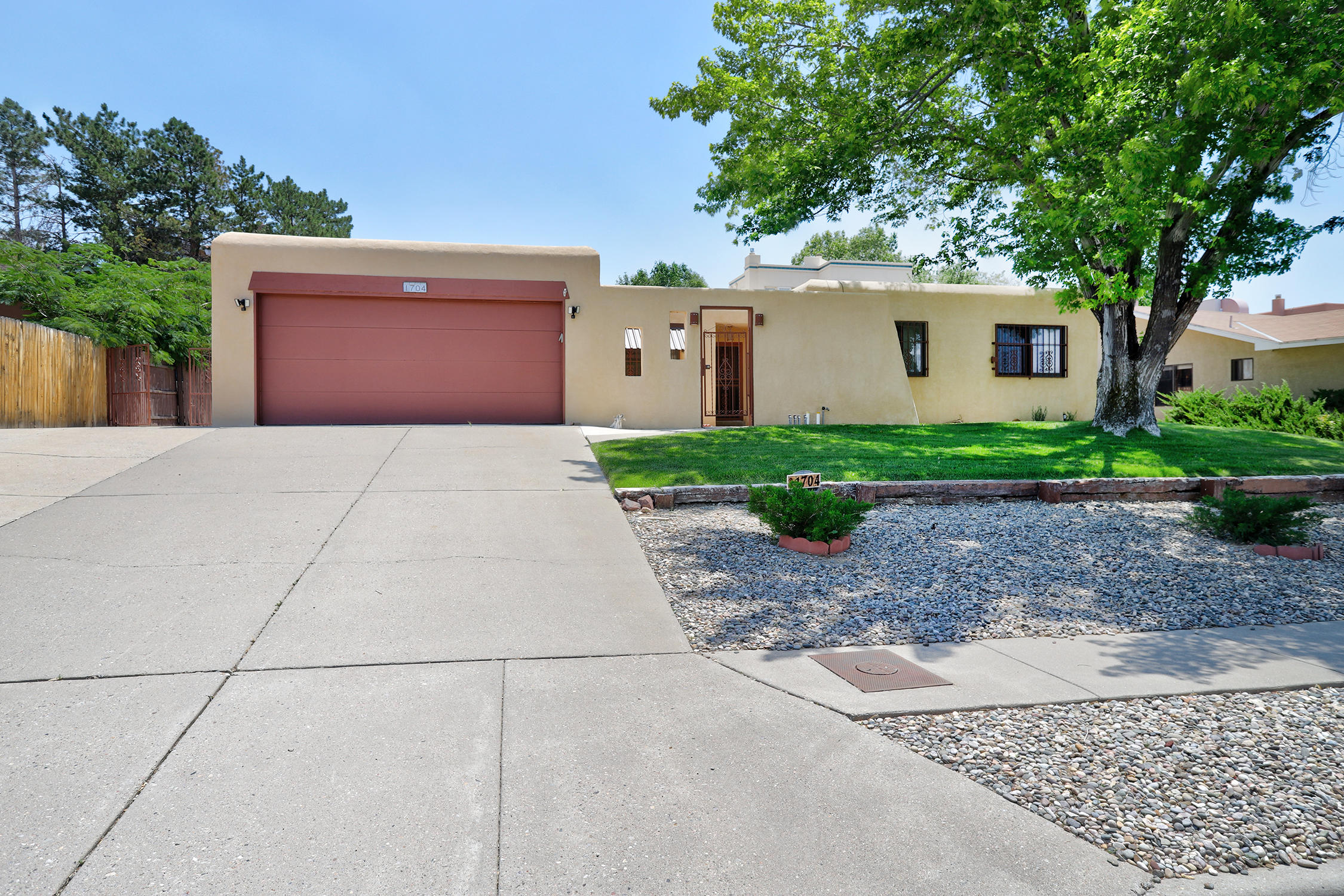 This Beauty has a Great 4 Bedroom Floorplan! Private Courtyard Entrance, a Vaulted Ceiling In Large Family Room with Vaulted Ceilings, Clerestory Windows and a Gas Log Kiva Fireplace. Bright Cook's Kitchen with Sunny Breakfast Nook, Full size Laundry Room, 2nd Living area and Dining Room! All Bedrooms are nice size and Owner's Suite has a Double Sink Bath Plus Walk-in Closet. Lush Backyard with Covered Patio and Backyard Access and long pad is perfect for All Your Toys! Do Not Miss ONE!!